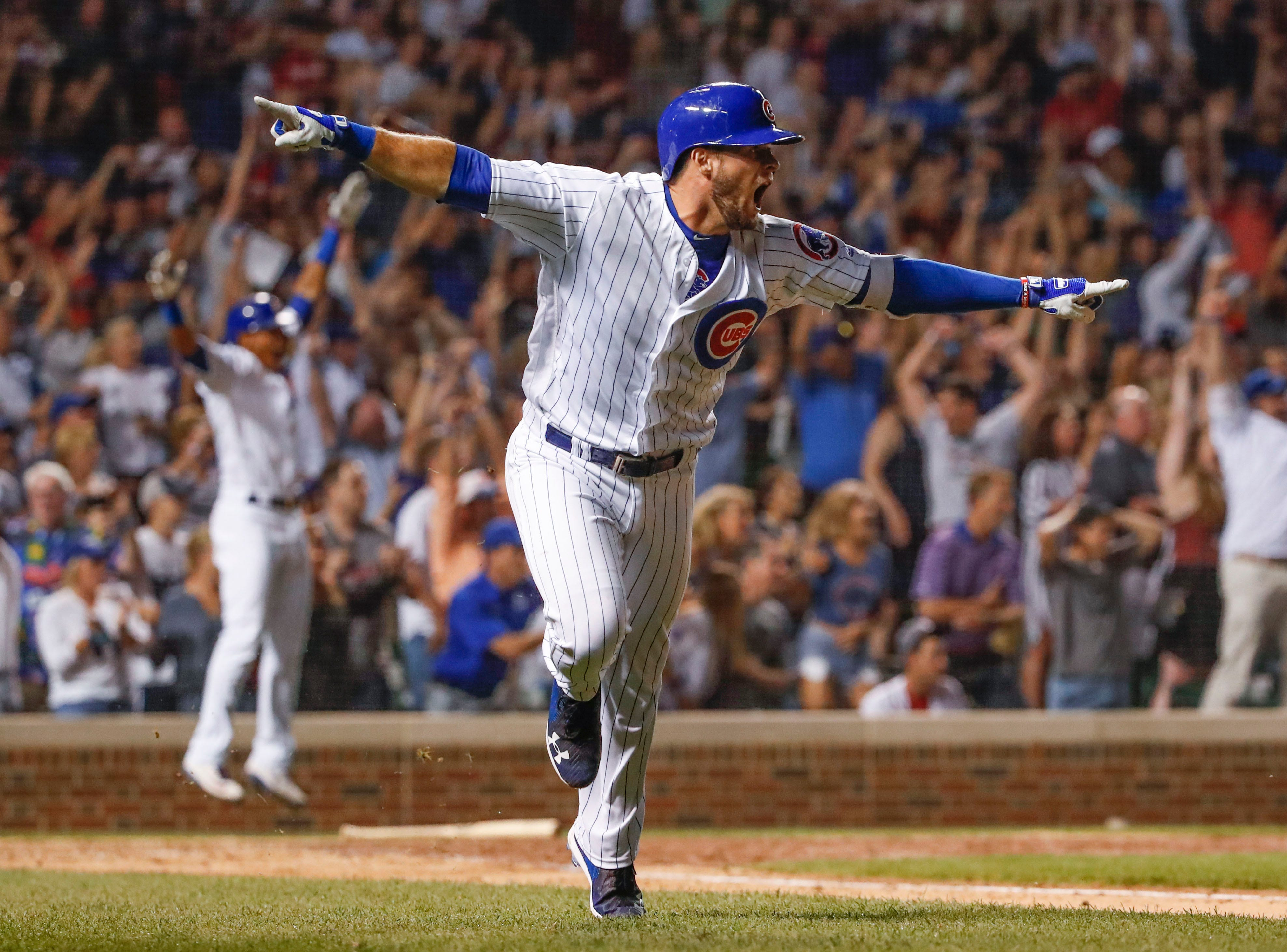 Aug. 12: Chicago Cubs third baseman David Bote rounds the bases after hitting a walk-off grand slam against the Washington Nationals at Wrigley Field.