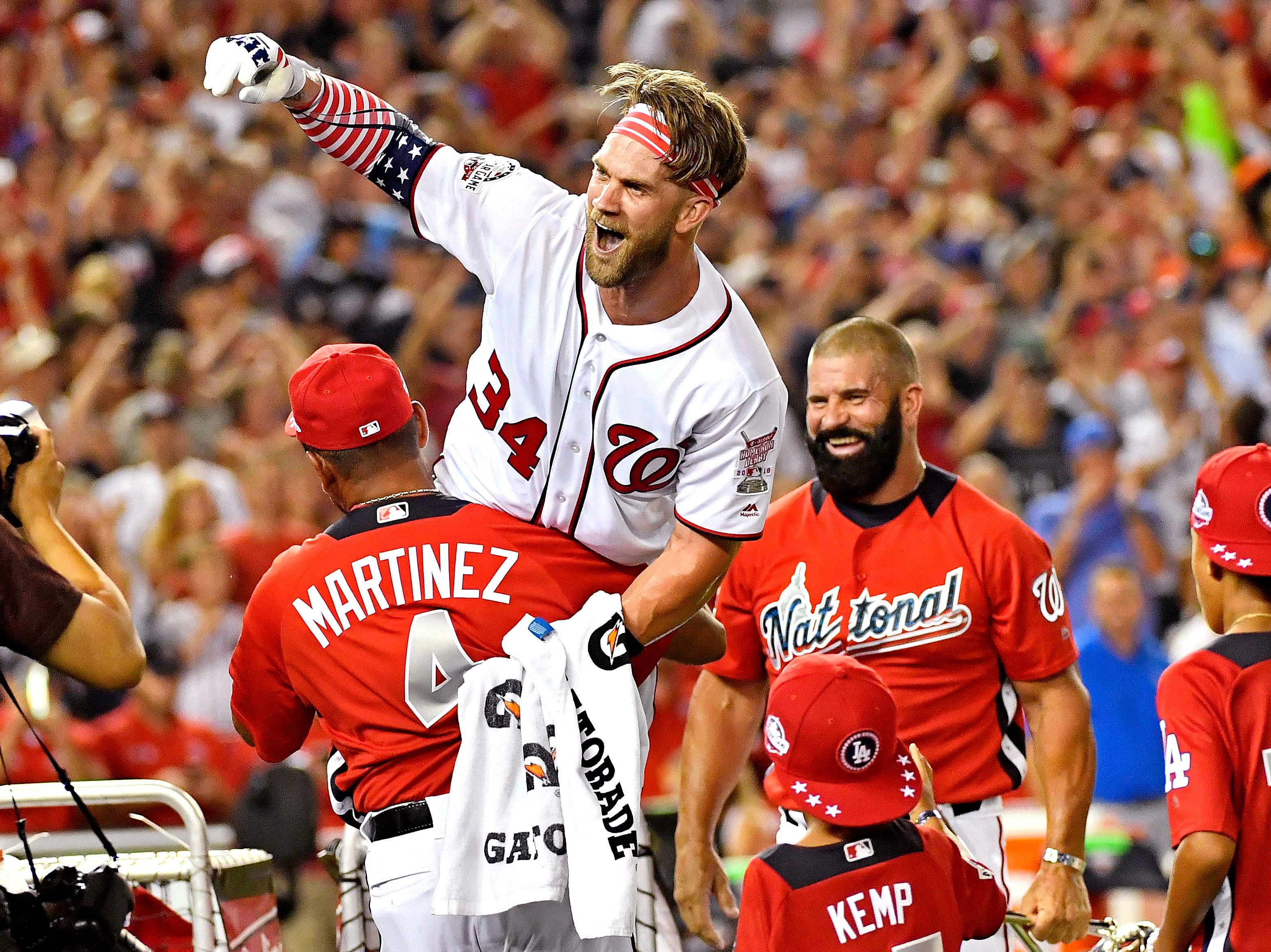 July 16: Washington Nationals right fielder Bryce Harper celebrates after winning the Home Run Derby at Nationals Park.