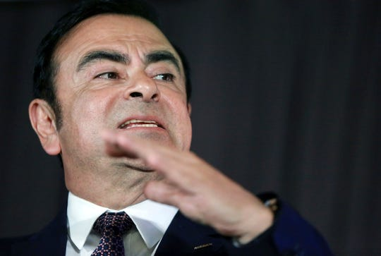 In this May 12, 2016, photo, then Nissan Motor Co. President and CEO Carlos Ghosn speaks during a joint press conference with Mitsubishi Motors Corp. in Yokohama, near Tokyo. The Tokyo District Court decided Ghosn and another executive Greg Kelly, both arrested Nov. 19 for allegedly falsifying financial reports to underreport Ghosn's pay, will remain in custody through Dec. 20.