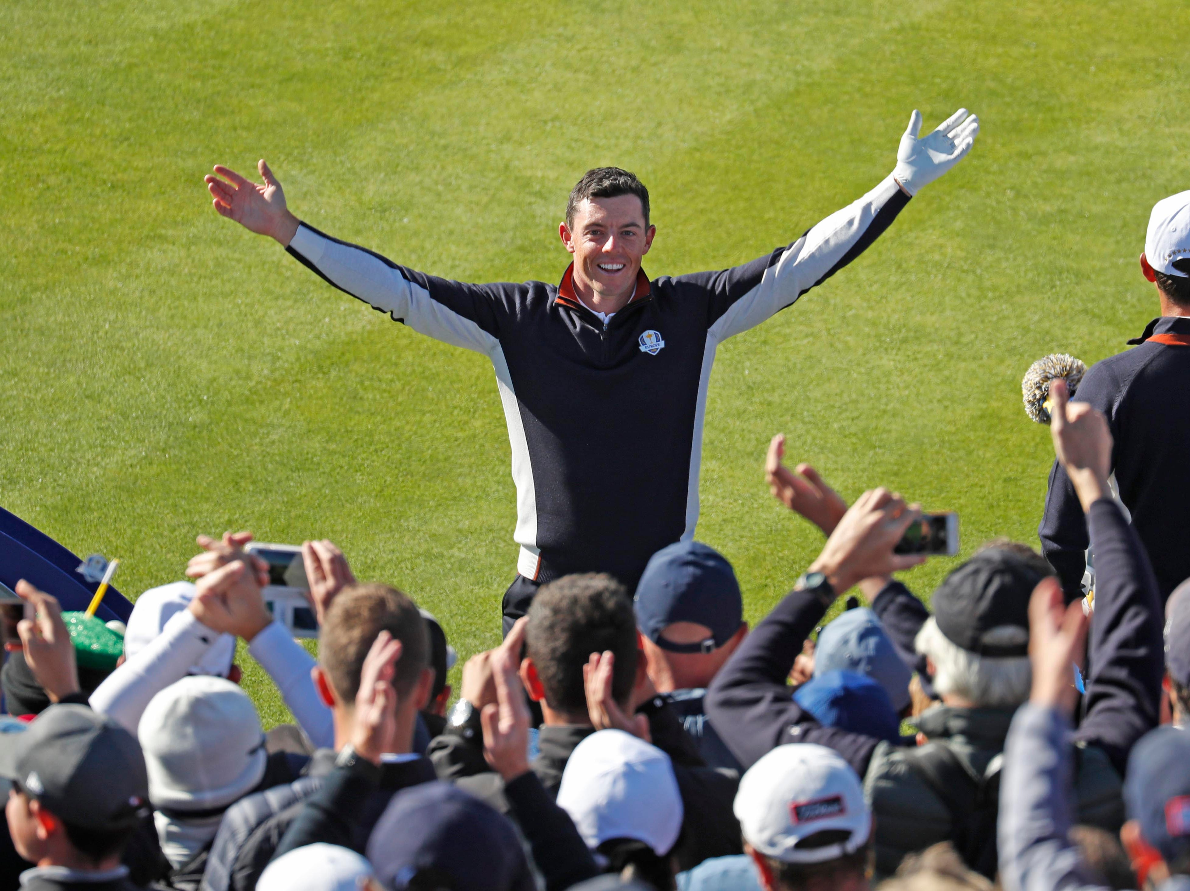 Sept. 26: Rory McIlroy leads the European fans in a cheer on the first tee during a Ryder Cup practice round.