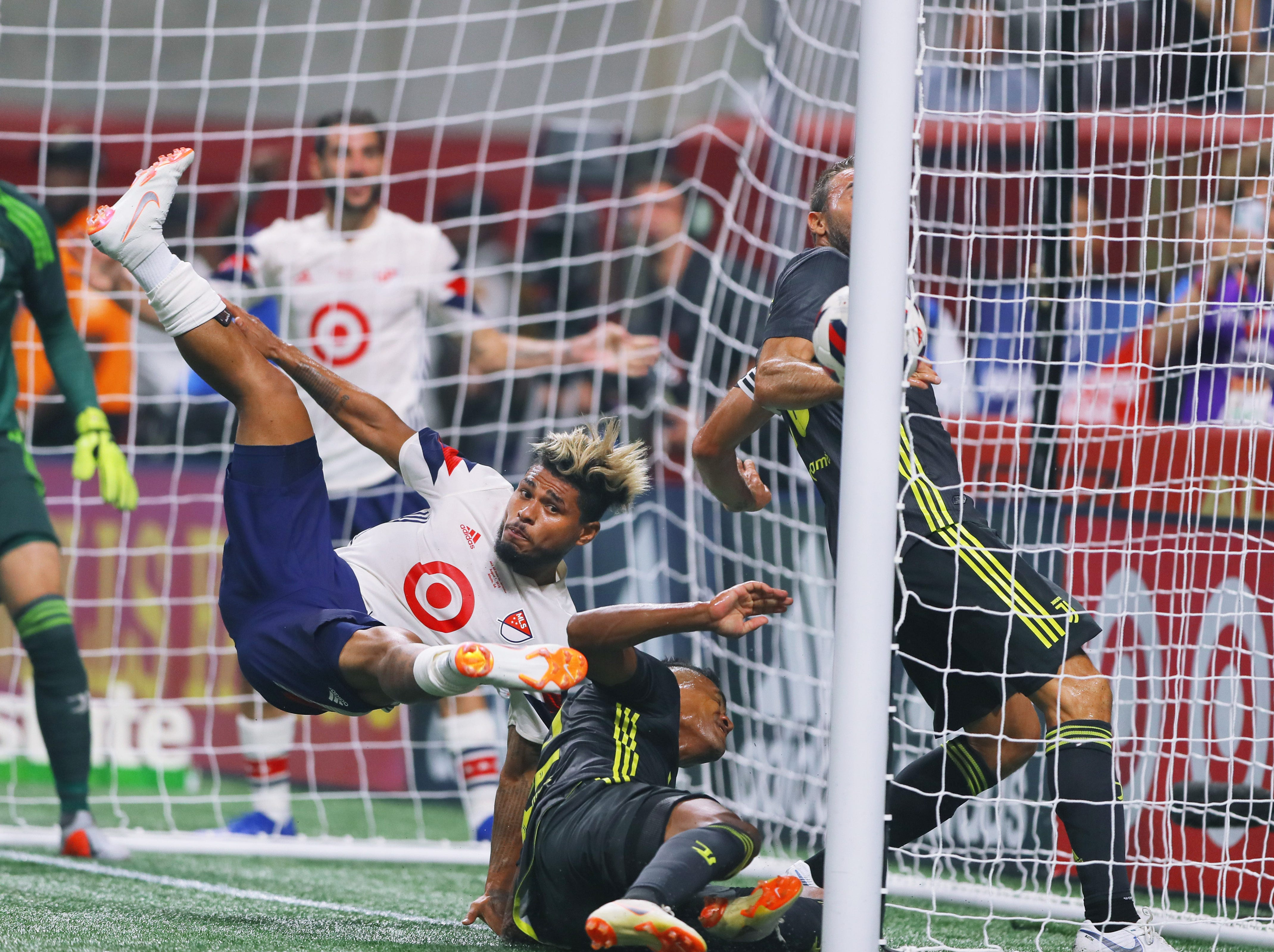 Aug. 1: Josef Martinez (17) flies through the air as he heads the ball in for a goal against Juventus in the first half in the MLS All-Star Game at Mercedes-Benz Stadium.