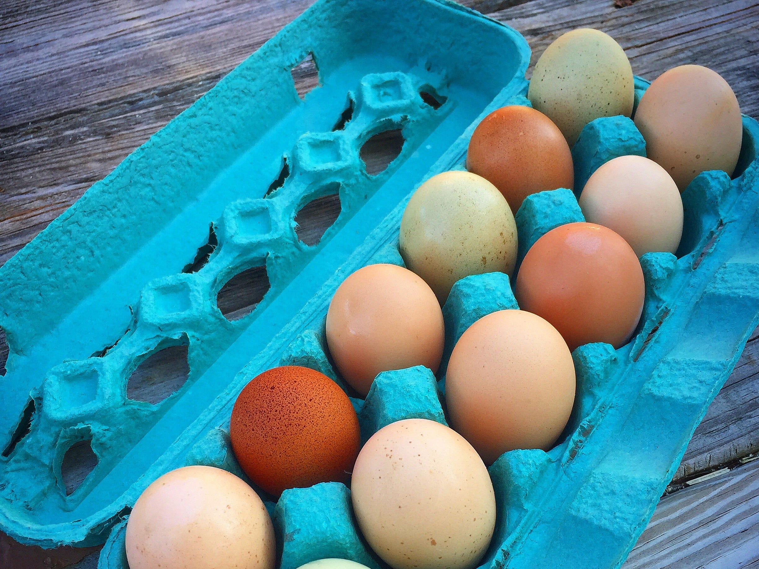 Danielle Raad packages some of the colorful eggs she collects from her chickens to sell locally.