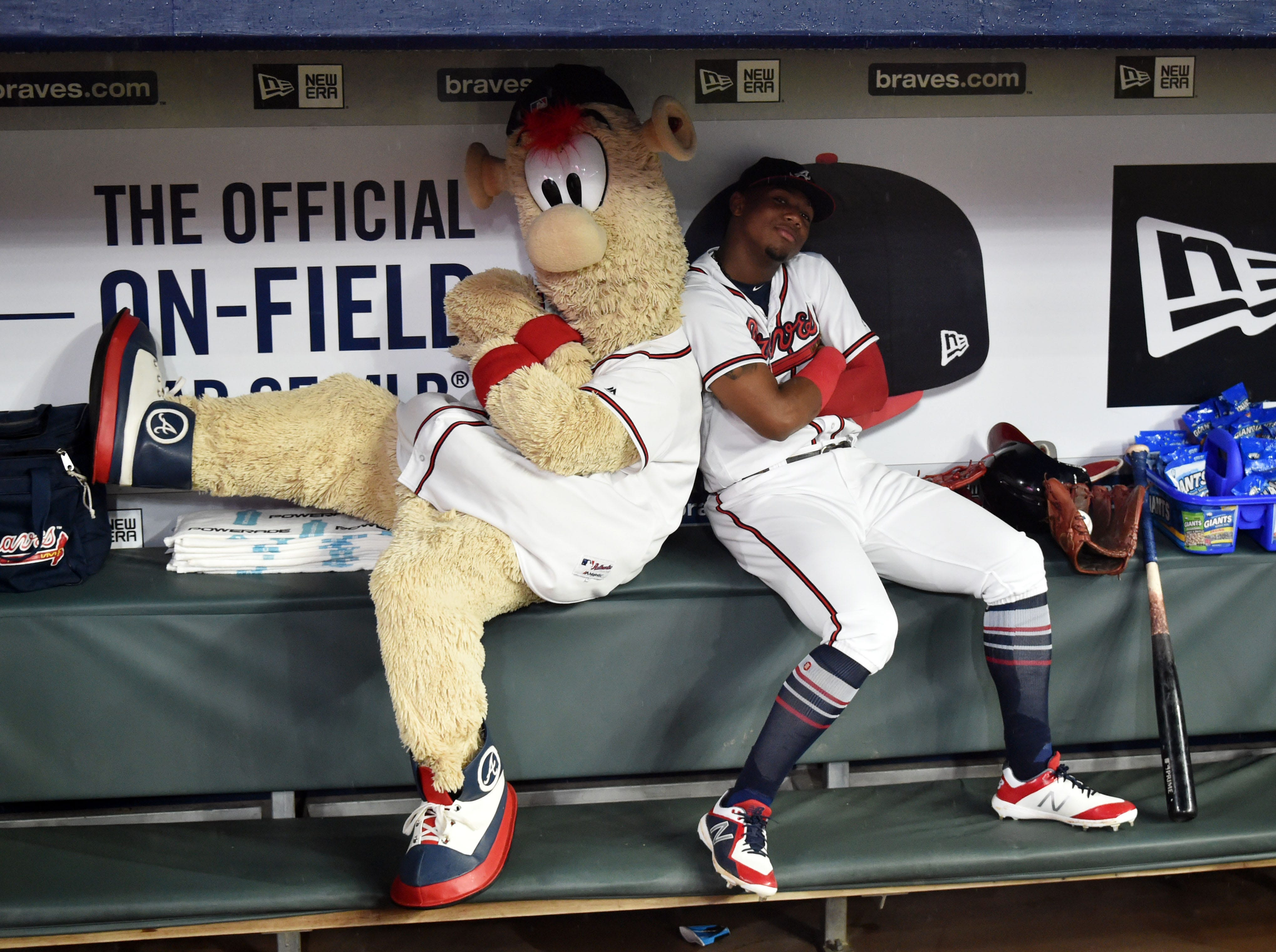 July 31: Atlanta Braves left fielder Ronald Acuna Jr. poses with mascot Blooper during a rain delay against the Miami Marlins at SunTrust Park.