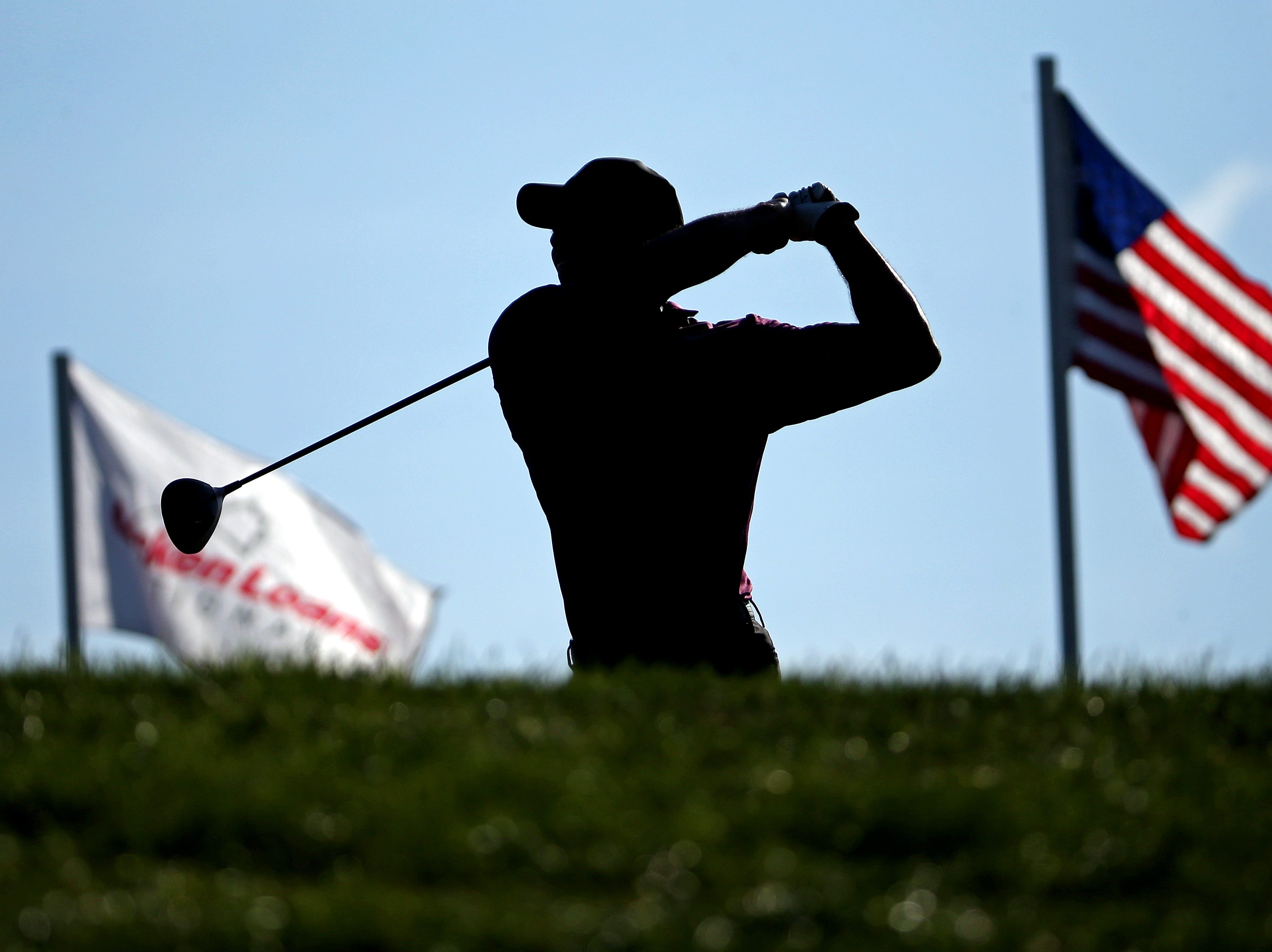 June 29: Tiger Woods warms up before the second round of The National golf tournament at TPC Potomac at Avenel Farm.