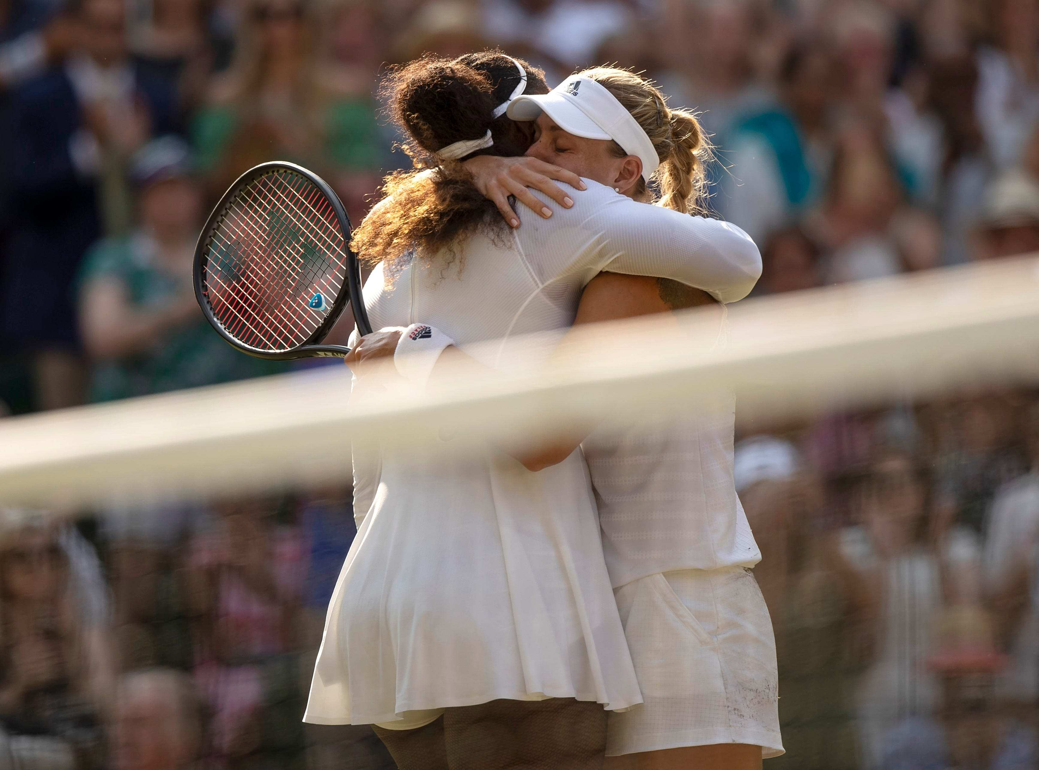 July 14: Serena Williams (USA), left, and Angelique Kerber (GER) meet at the net after Kerber's win in the Wimbledon final.