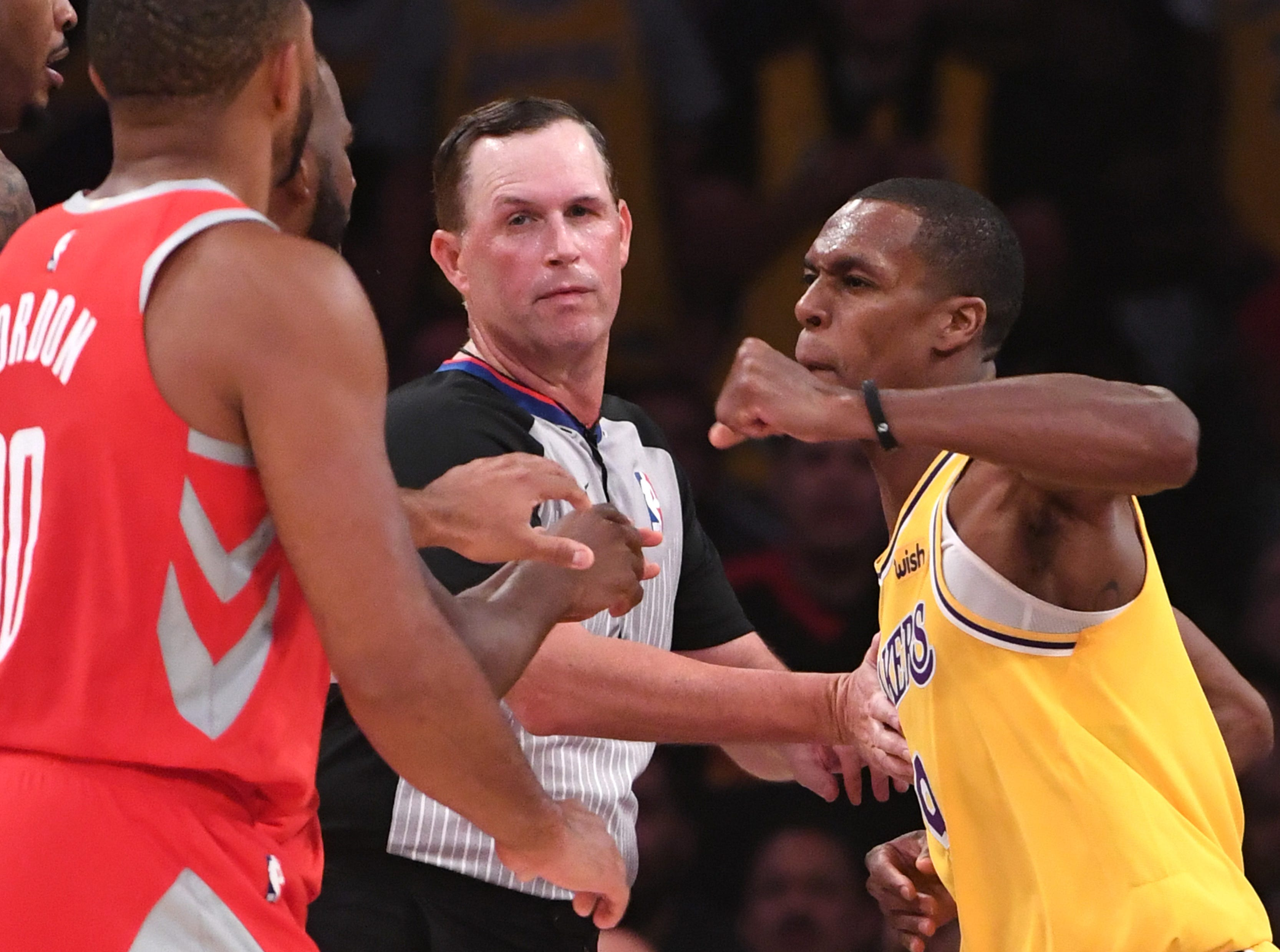 Oct. 20: Los Angeles Lakers guard Rajon Rondo (9) throws a punch at Houston Rockets guard Chris Paul during a fight in the fourth quarter of the game at Staples Center.