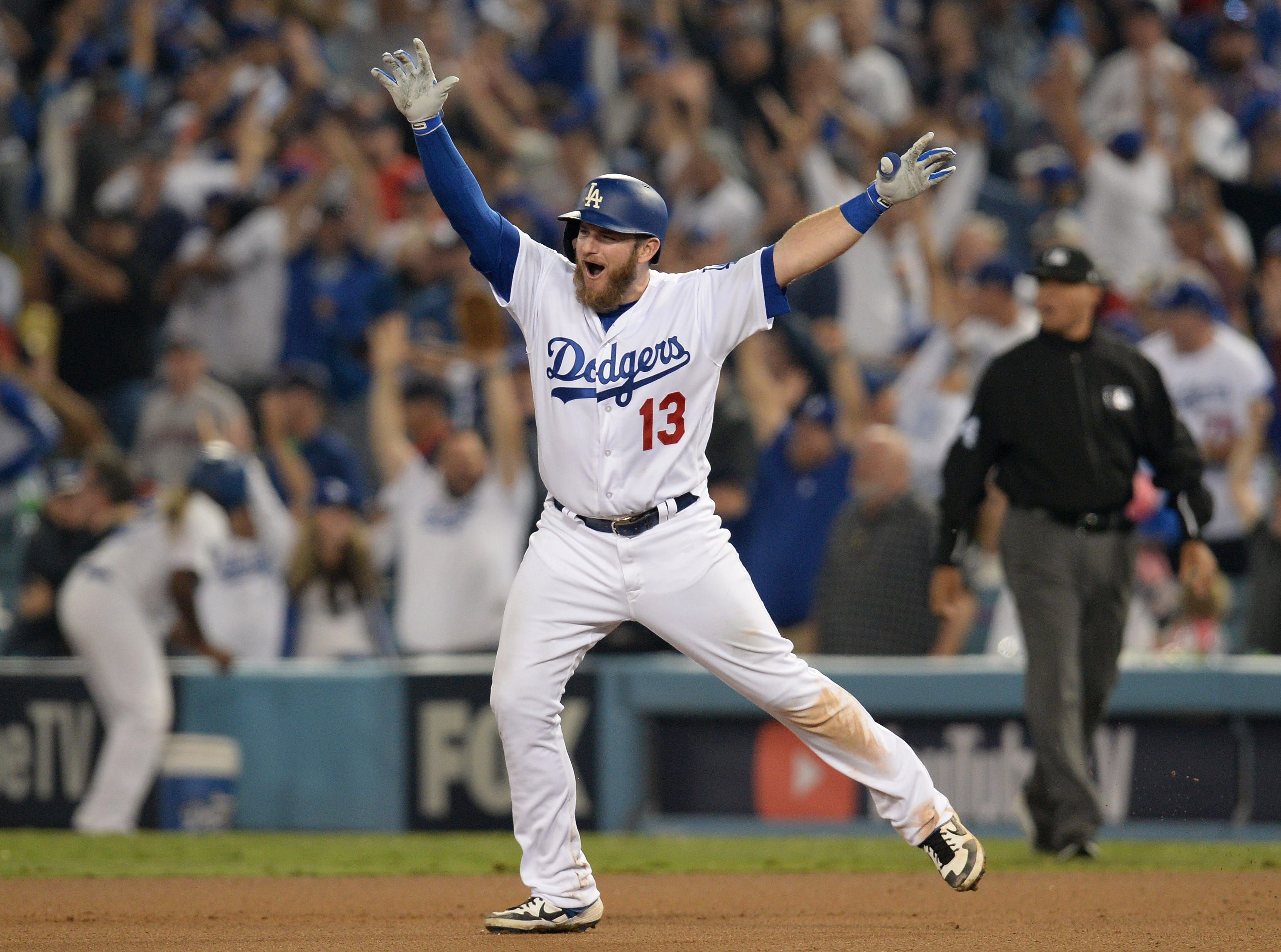 Oct. 26: Los Angeles Dodgers first baseman Max Muncy celebrates after hitting a walk-off home run against the Boston Red Sox in the 18th inning in Game 3 of the World Series.