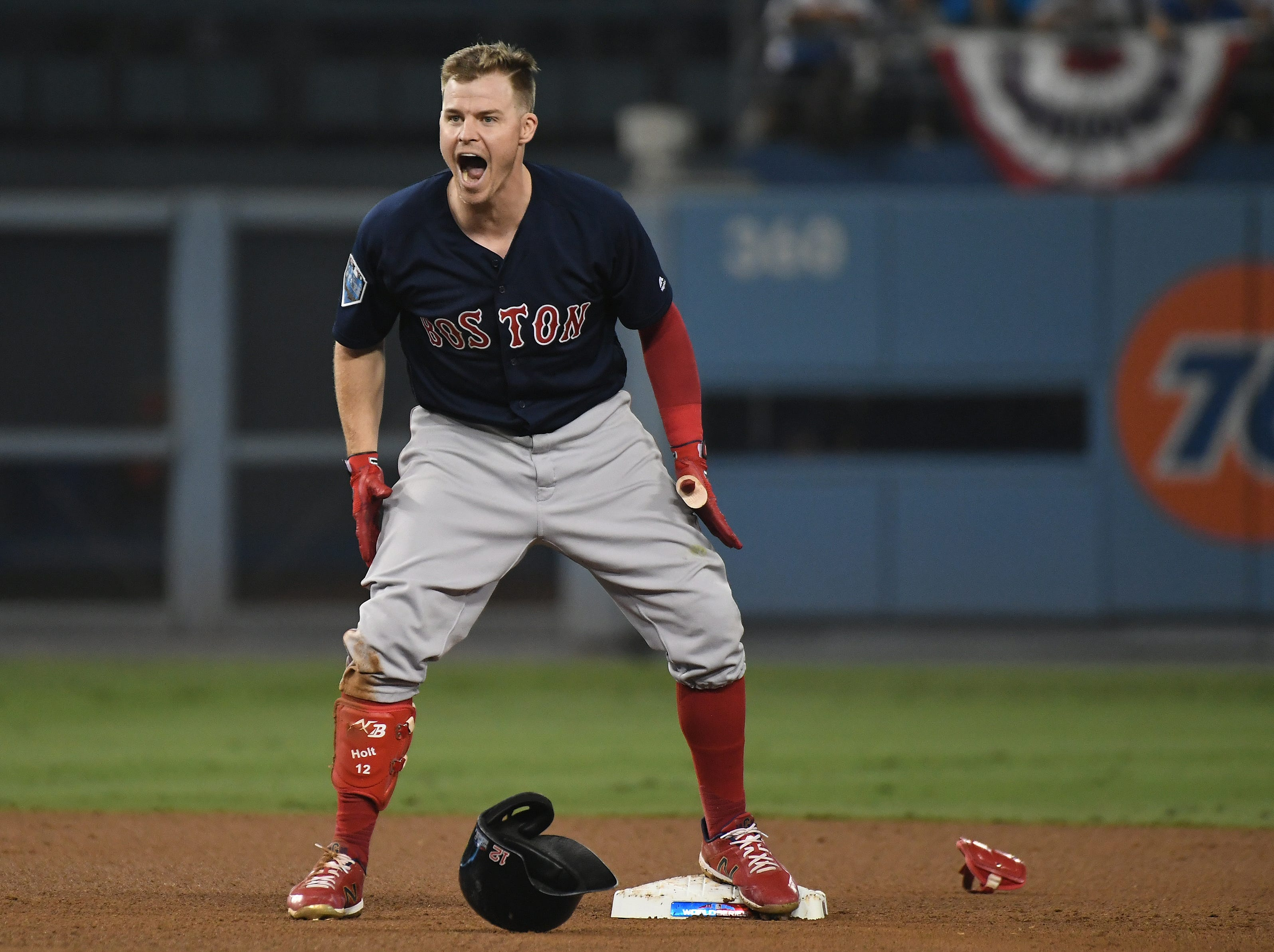 Oct. 27: Boston Red Sox second baseman Brock Holt reacts after hitting a double in the ninth inning against the Los Angeles Dodgers in Game 4 of the World Series.