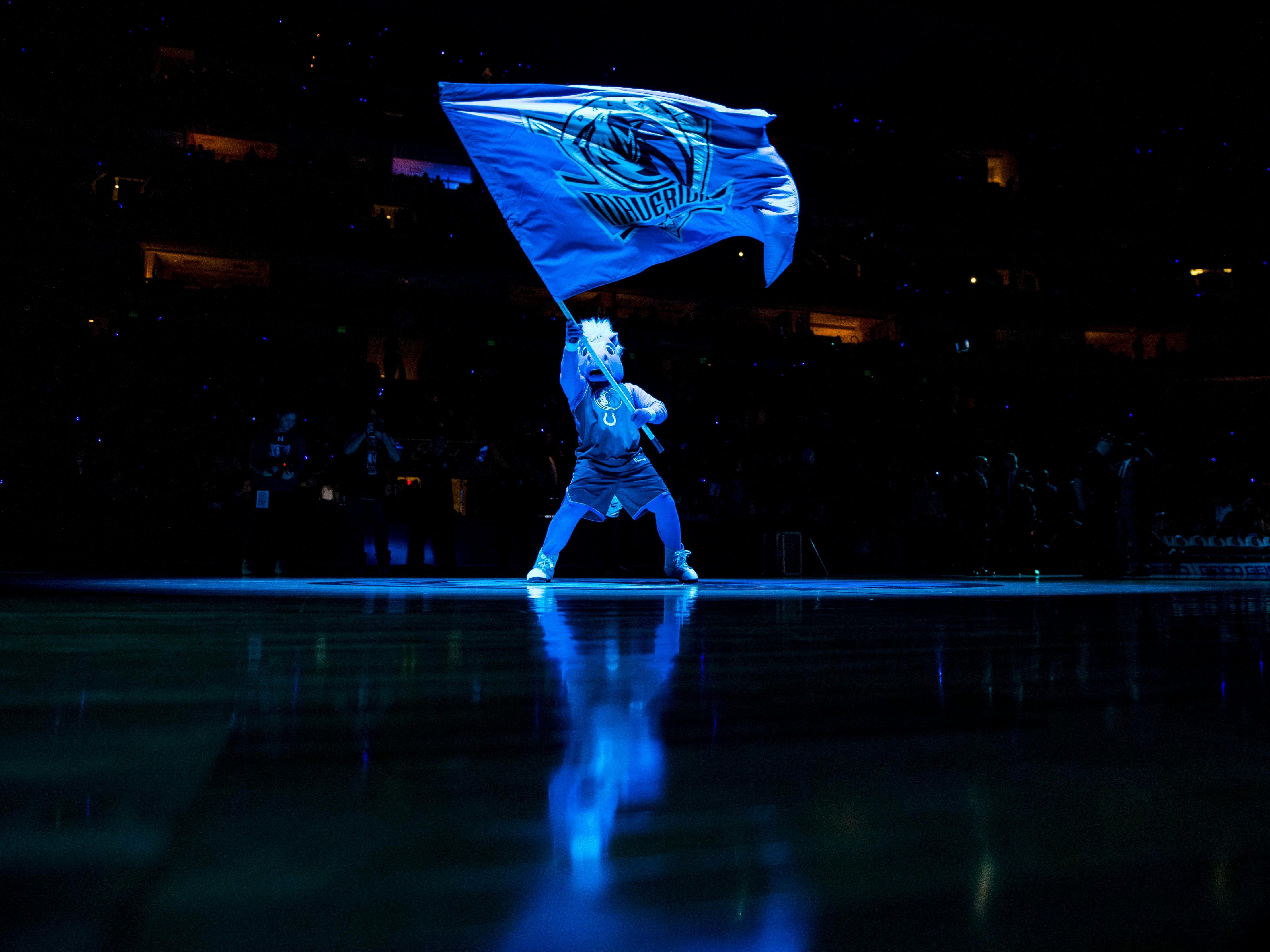 Dec. 10: The Mavericks mascot flies the team flag before a game against the Magic.