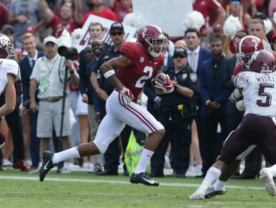 Alabama DB Patrick Surtain II returns an interception against Texas A&M.