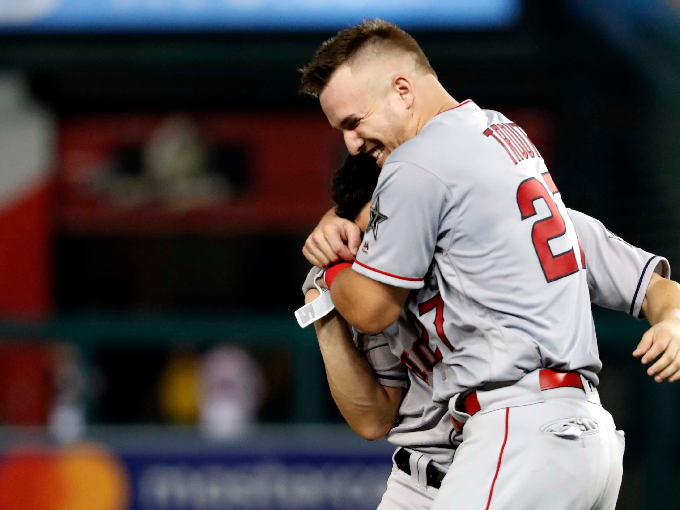 July 17: Mike Trout of the Los Angeles Angels  jokes with Jose Altuve of the Houston Astros during the fifth inning of the MLB All-Star Game at Nationals Park.