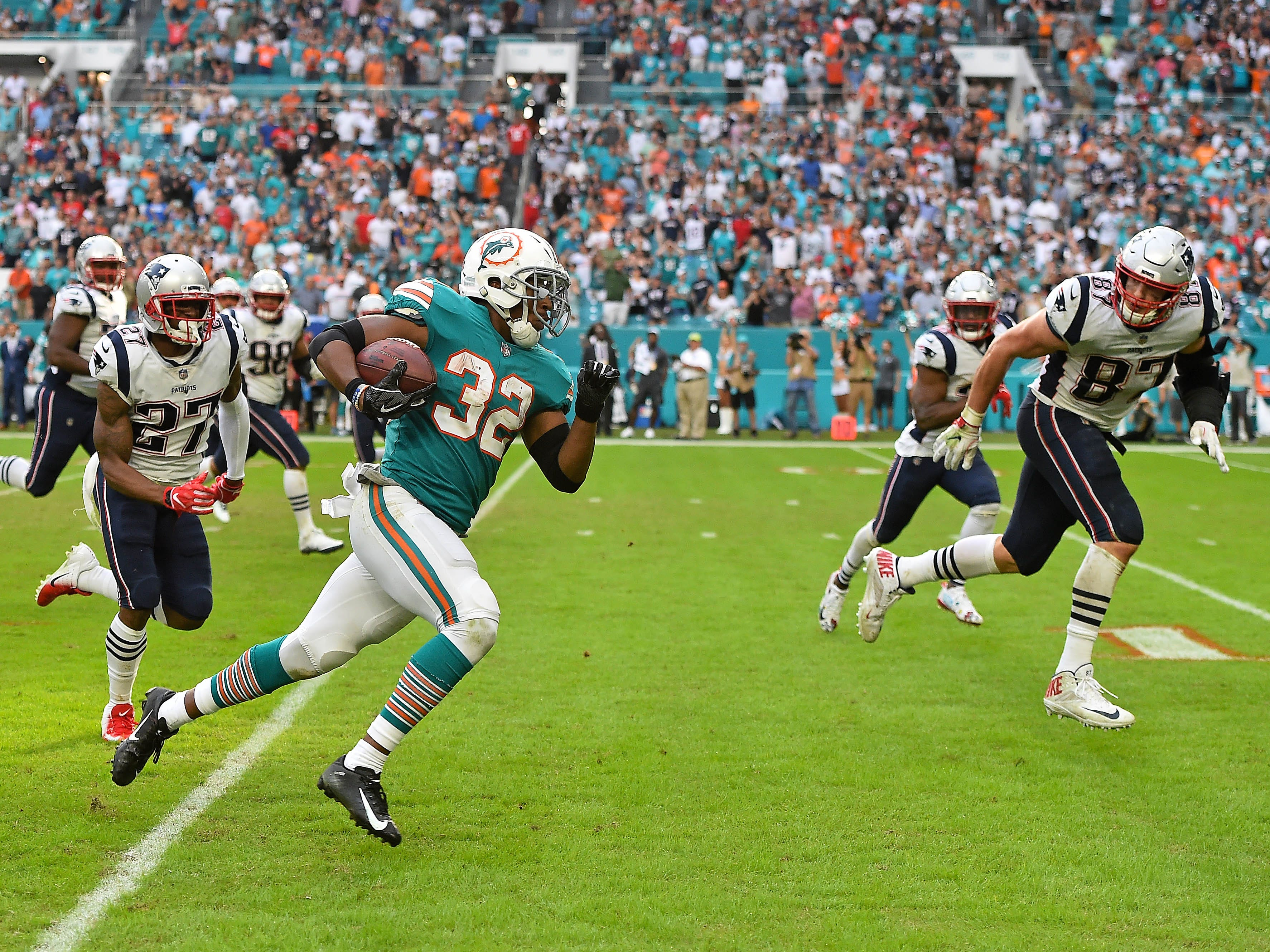 Week 14: Miami Dolphins running back Kenyan Drake runs the ball after a lateral  to score a walk-off touchdown in a 34-33 win over the New England Patriots at Hard Rock Stadium.