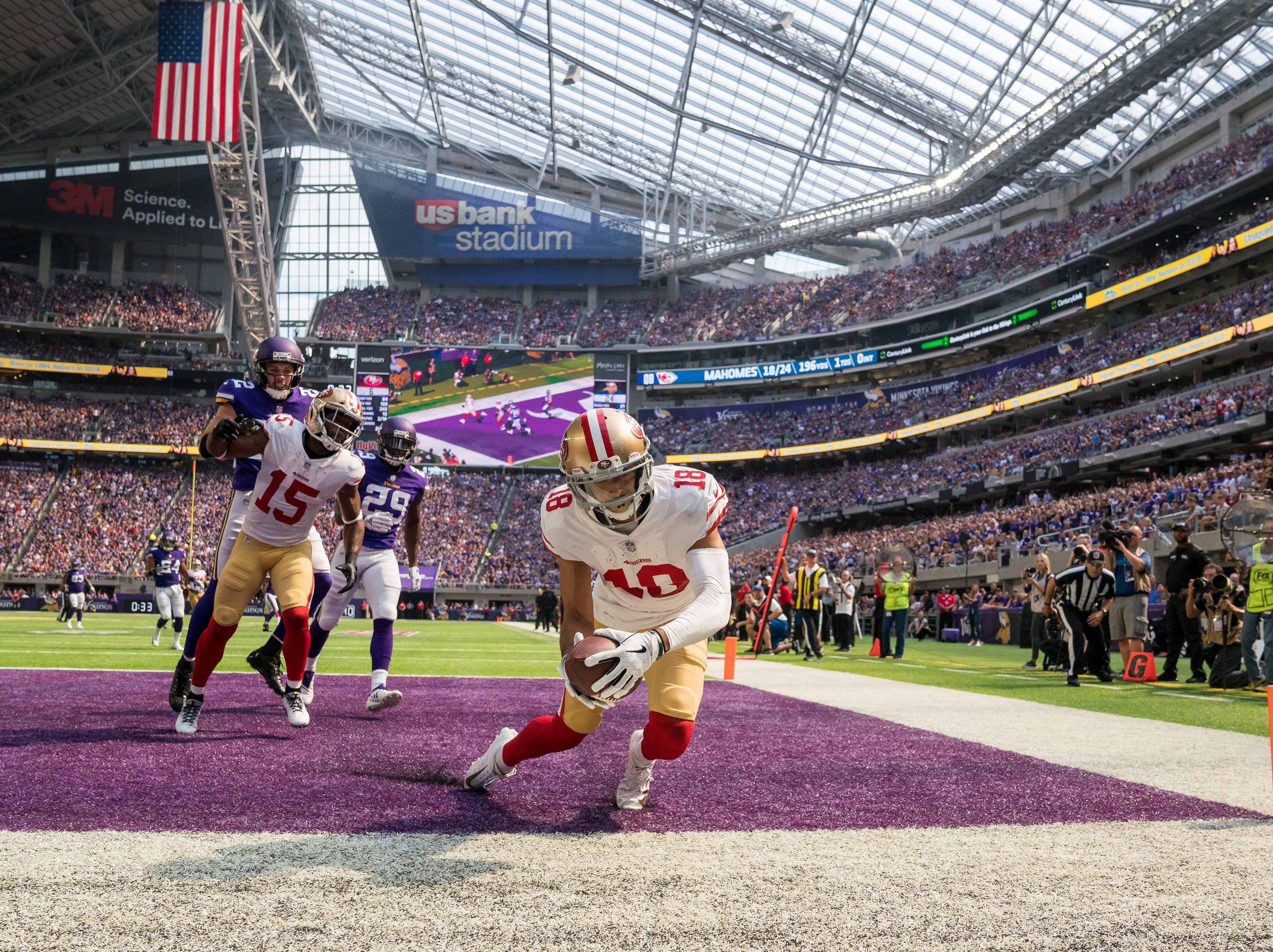 Sept. 9: San Francisco 49ers wide receiver Dante Pettis (18) catches a touchdown in the third quarter against Minnesota Vikings at U.S. Bank Stadium.