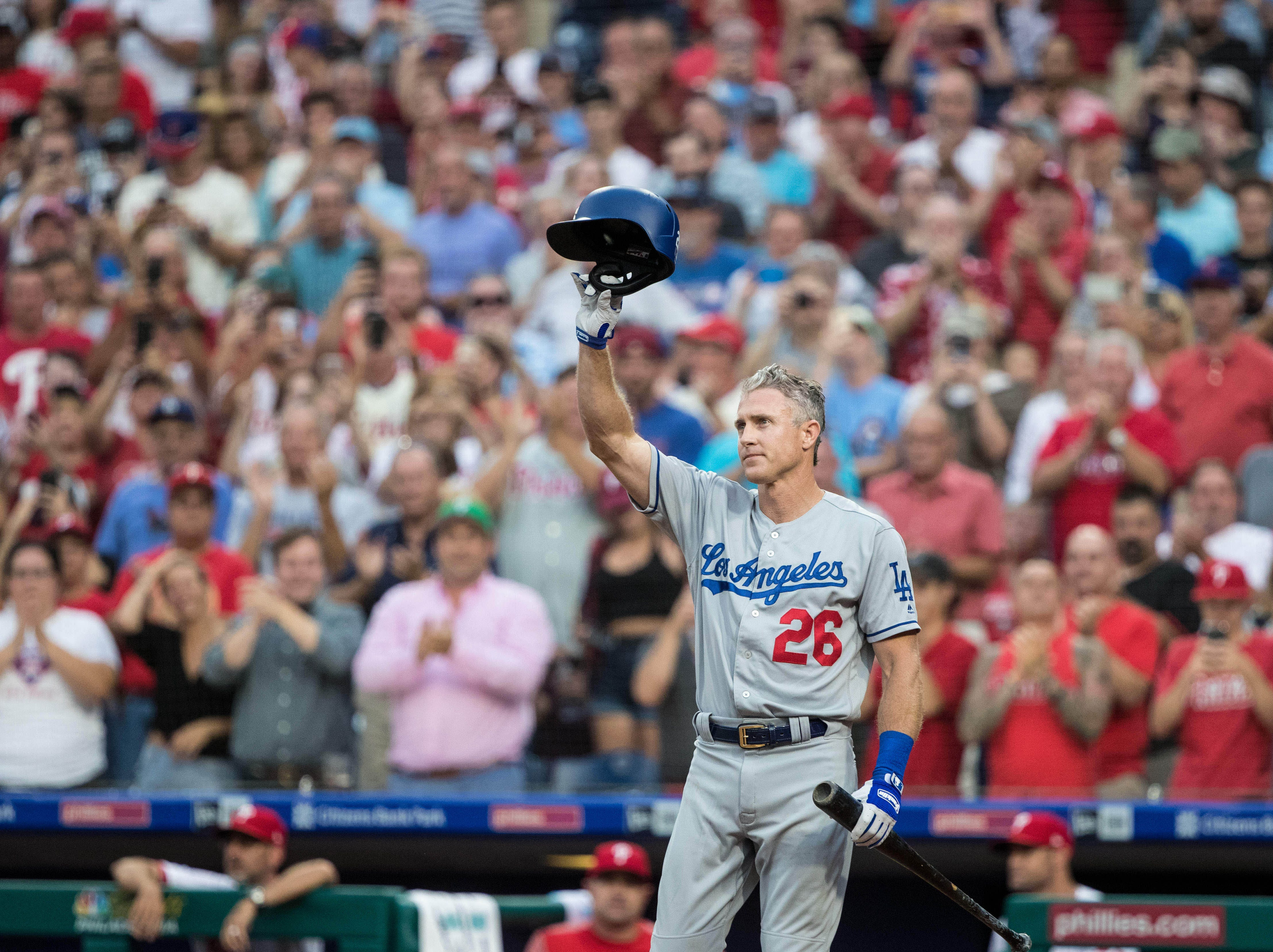 July 23: Los Angeles Dodgers second baseman Chase Utley tips his hat at the plate as he receives a standing ovation during the second inning against the Philadelphia Phillies at Citizens Bank Park.