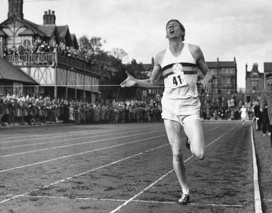 In this May 6, 1954, file photo, British athlete Roger Bannister breaks the tape to become the first man ever to break the four-minute barrier in the mile at Iffly Field in Oxford, England.
