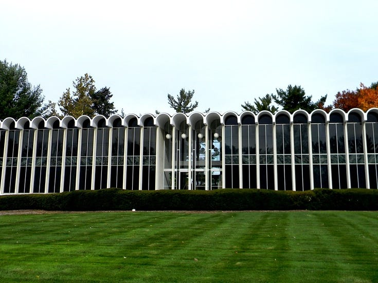 Michigan State Medical Society Building, East Lansing, 1961 (Architect: Minoru Yamasaki): Prominent features include the terraced landscape; tall, slender columns; repetitive arch roofline; and large windows. An addition to the building's west end was completed in 1979 and was also designed by the Yamasaki firm. The Michigan State Medical Society continues its stewardship of the mid-century modern building by maintaining and preserving the original design.  The building was listed in the National Register of Historic Places in 2011.