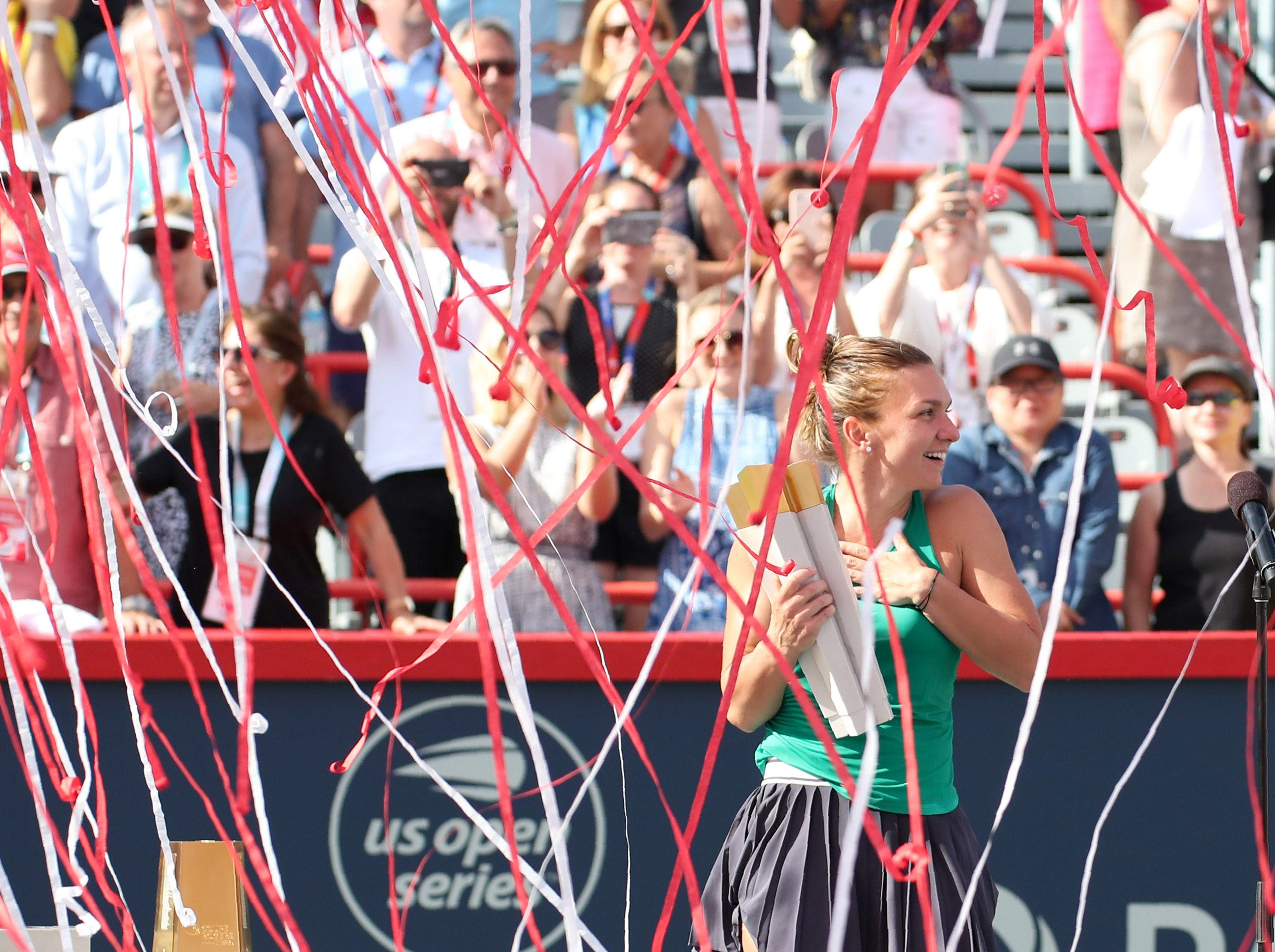 Aug. 12: Confetti falls on Simona Halep as she wins against Sloane Stephens in the Rogers Cup at Stade IGA.