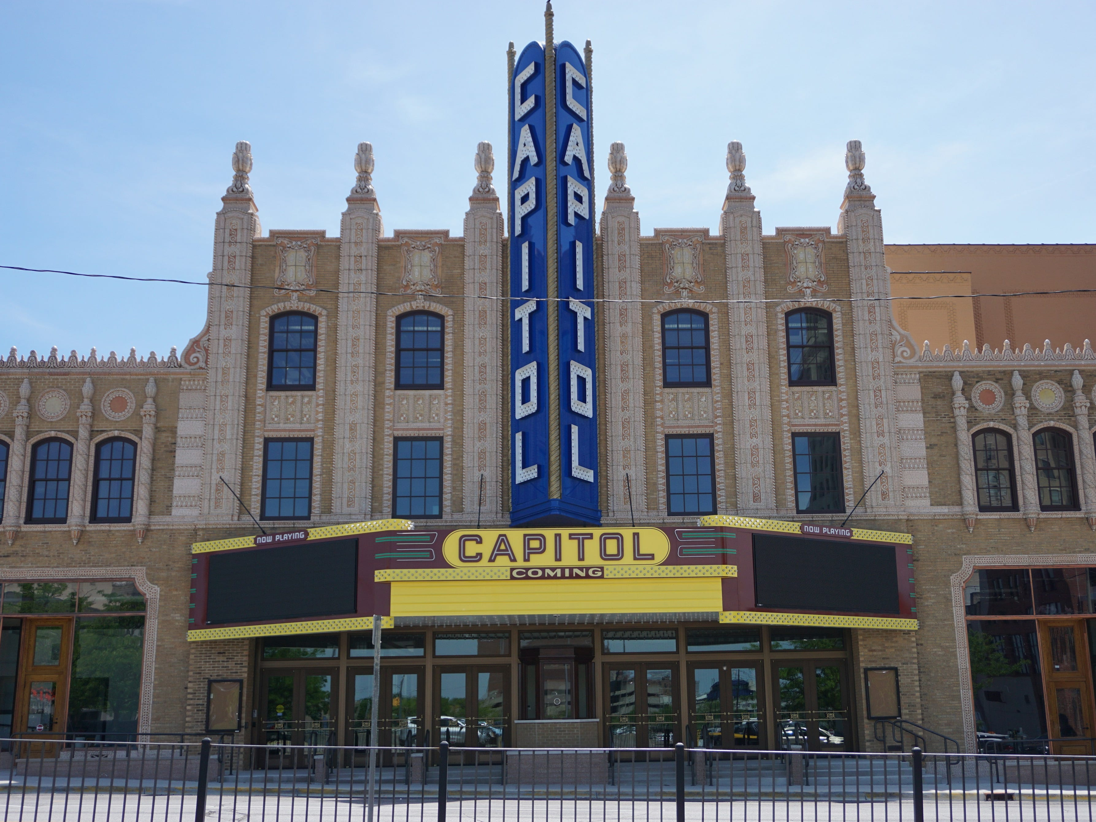 "Capitol Theater, Flint, 1927-1928 (Architect: John Eberson): Originally designed by John Eberson, known for his ""atmospheric"" interiors, the Capitol's theme was a Roman garden, complete with a sky-blue ceiling with twinkling stars at night. Facades of palaces, castles and  hanging gardens adorn the theater's interior. The exterior is comprised of buff-colored brick set off by terra cotta piers and copper-clad storefronts. Restoration work has brought the theater back to life inside and out."