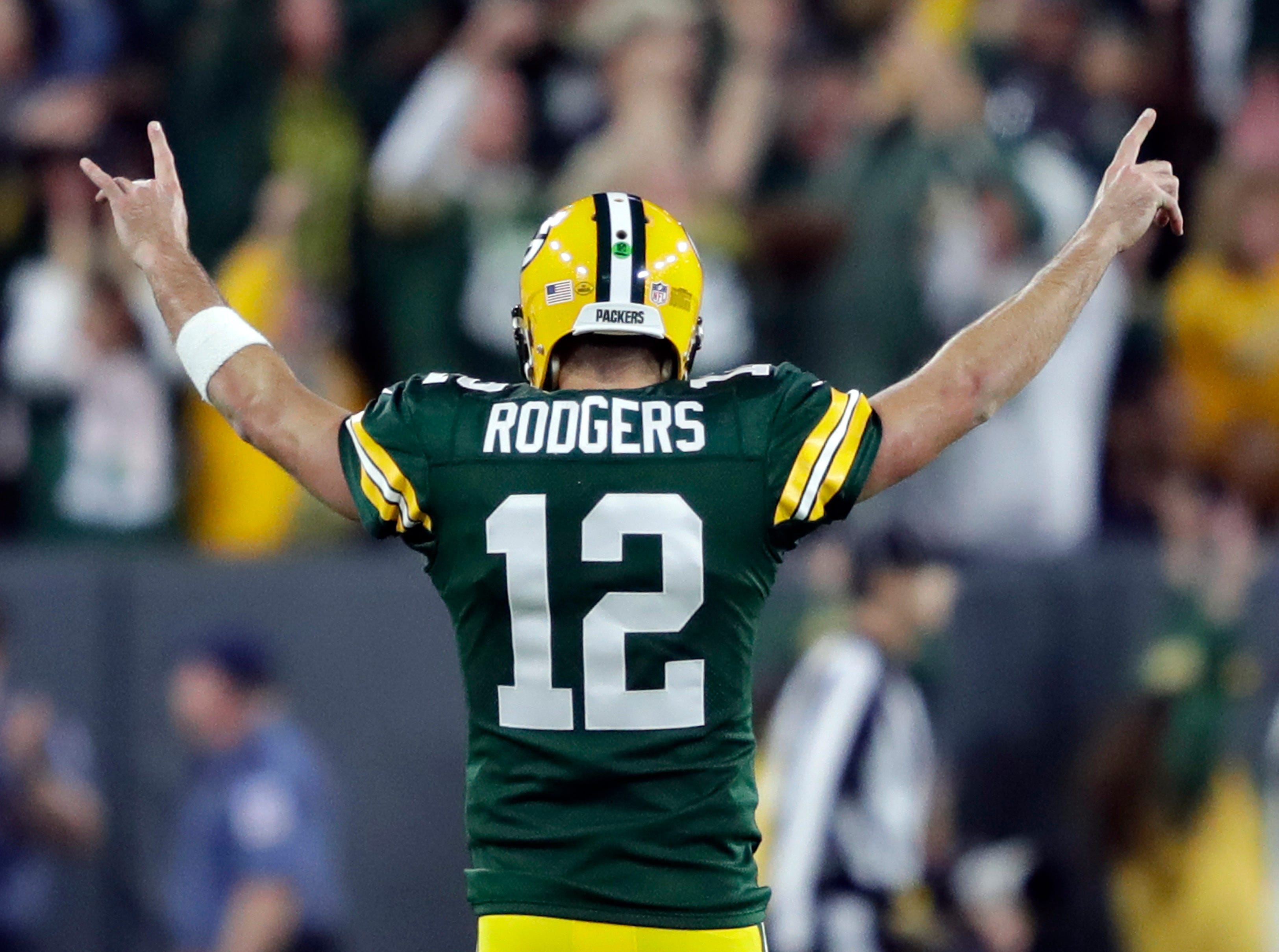 Sept. 9: Green Bay Packers quarterback Aaron Rodgers celebrates the game-winning touchdown pass to Randall Cobb late in the fourth quarter against the Chicago Bears at Lambeau Field, capping a huge comeback that included an injury scare for Rodgers.