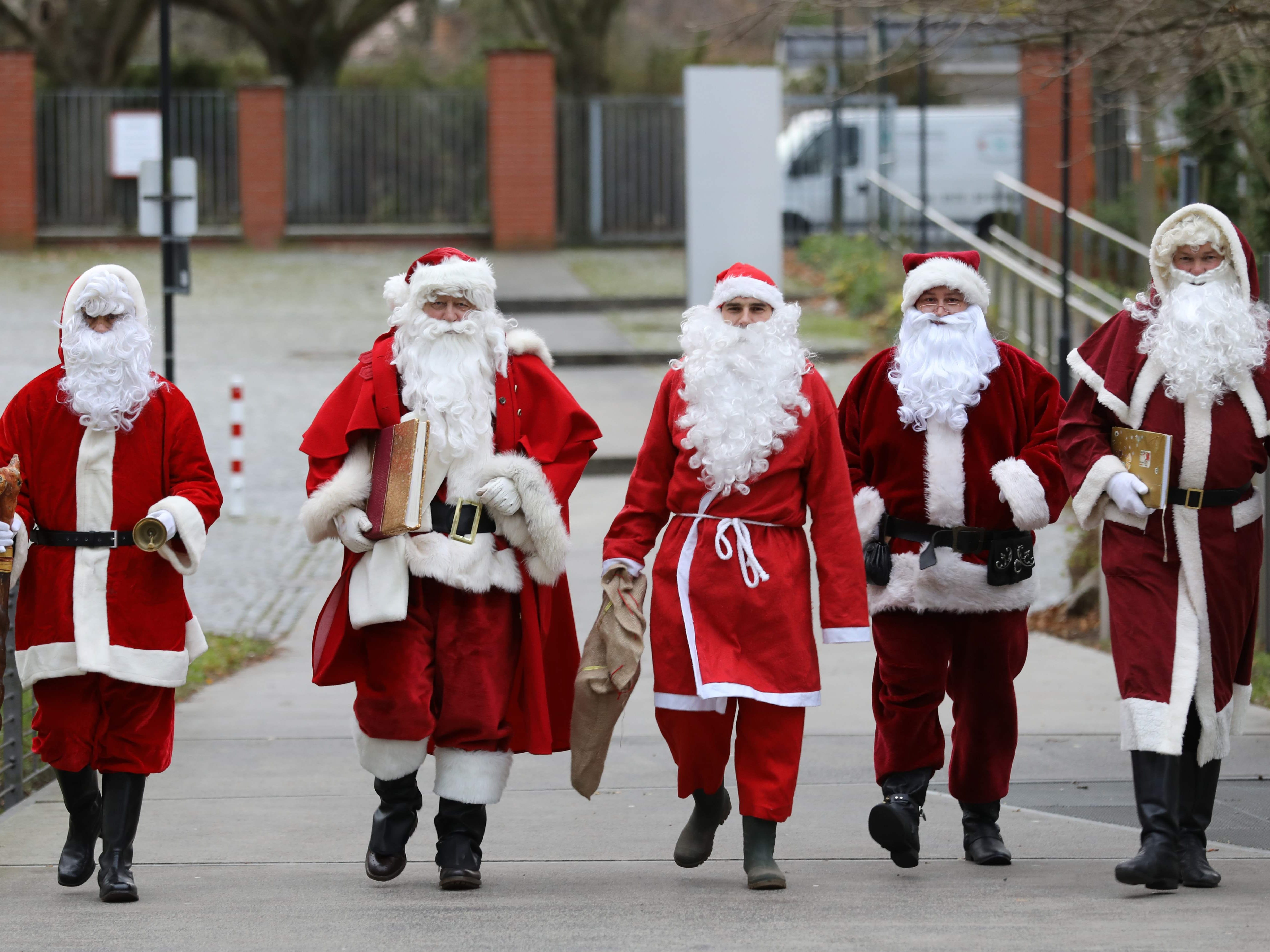 These are candidates for a job at the Santa Claus agency in Rostock,  Germany, Dec. 11, 2018.