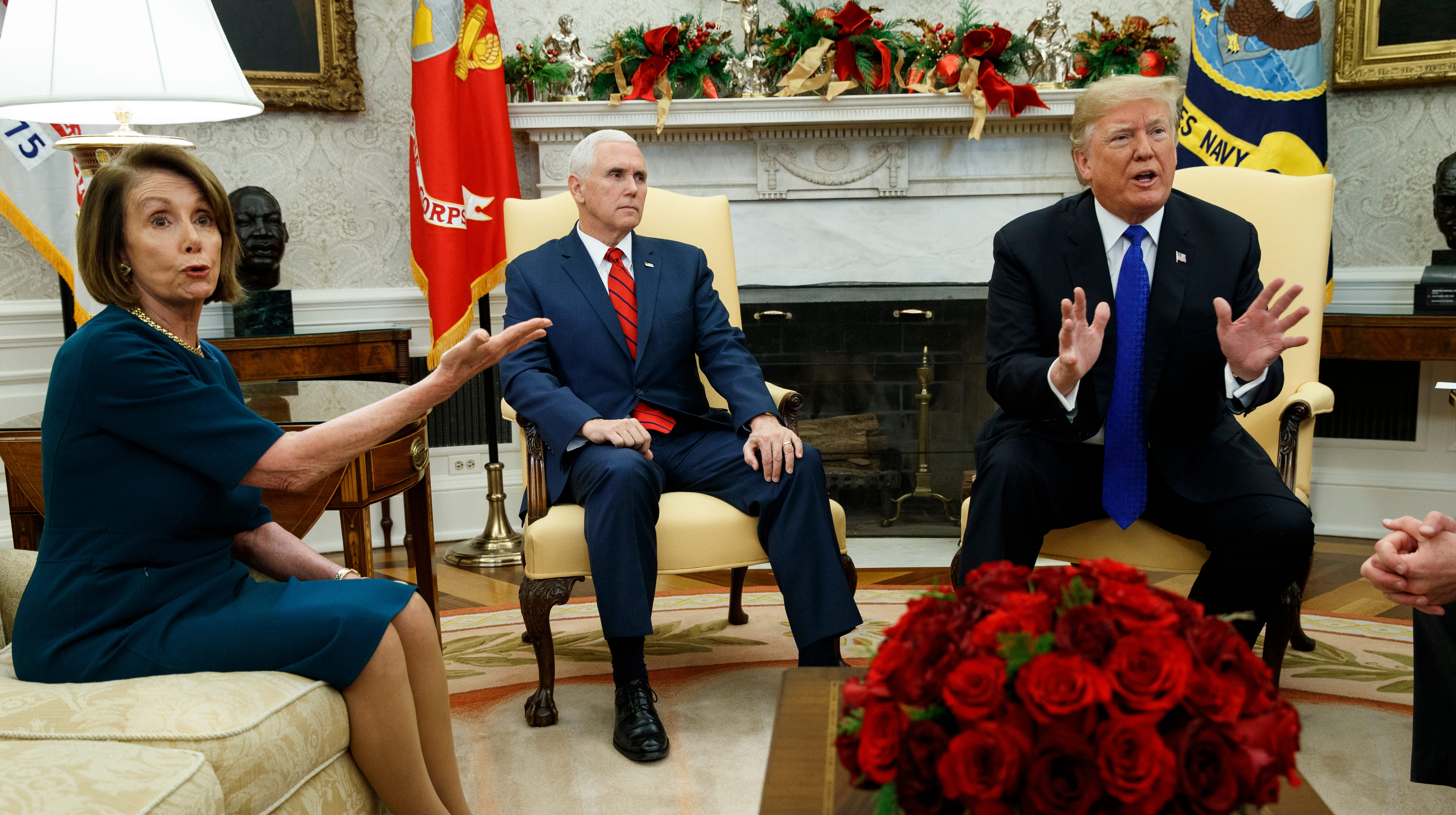 Vice President Mike Pence, center, looks on as House Minority Leader Rep. Nancy Pelosi, D-Calif., argues with President Donald Trump during a meeting in the Oval Office of the White House Dec. 11, 2018, in Washington.