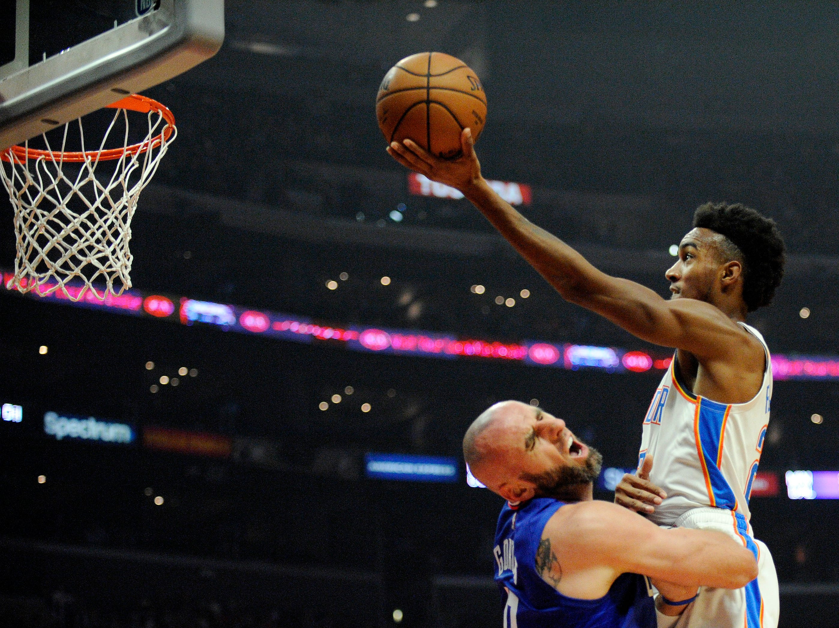 Oct. 19: Oklahoma City Thunder guard Terrance Ferguson (23) moves in to score a basket against Los Angeles Clippers center Marcin Gortat (13) during the first half at Staples Center.