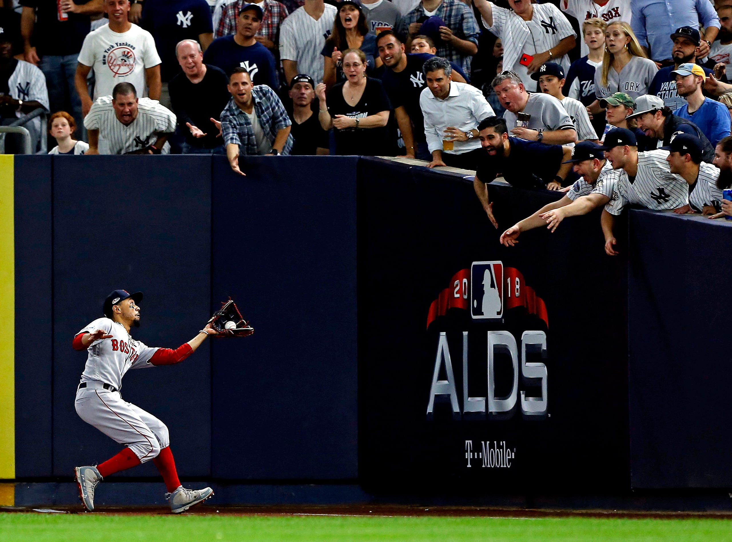 Oct. 9: Boston Red Sox right fielder Mookie Betts (50) catches a fly ball during the seventh inning against the New York Yankees in Game 4 of the ALDS.