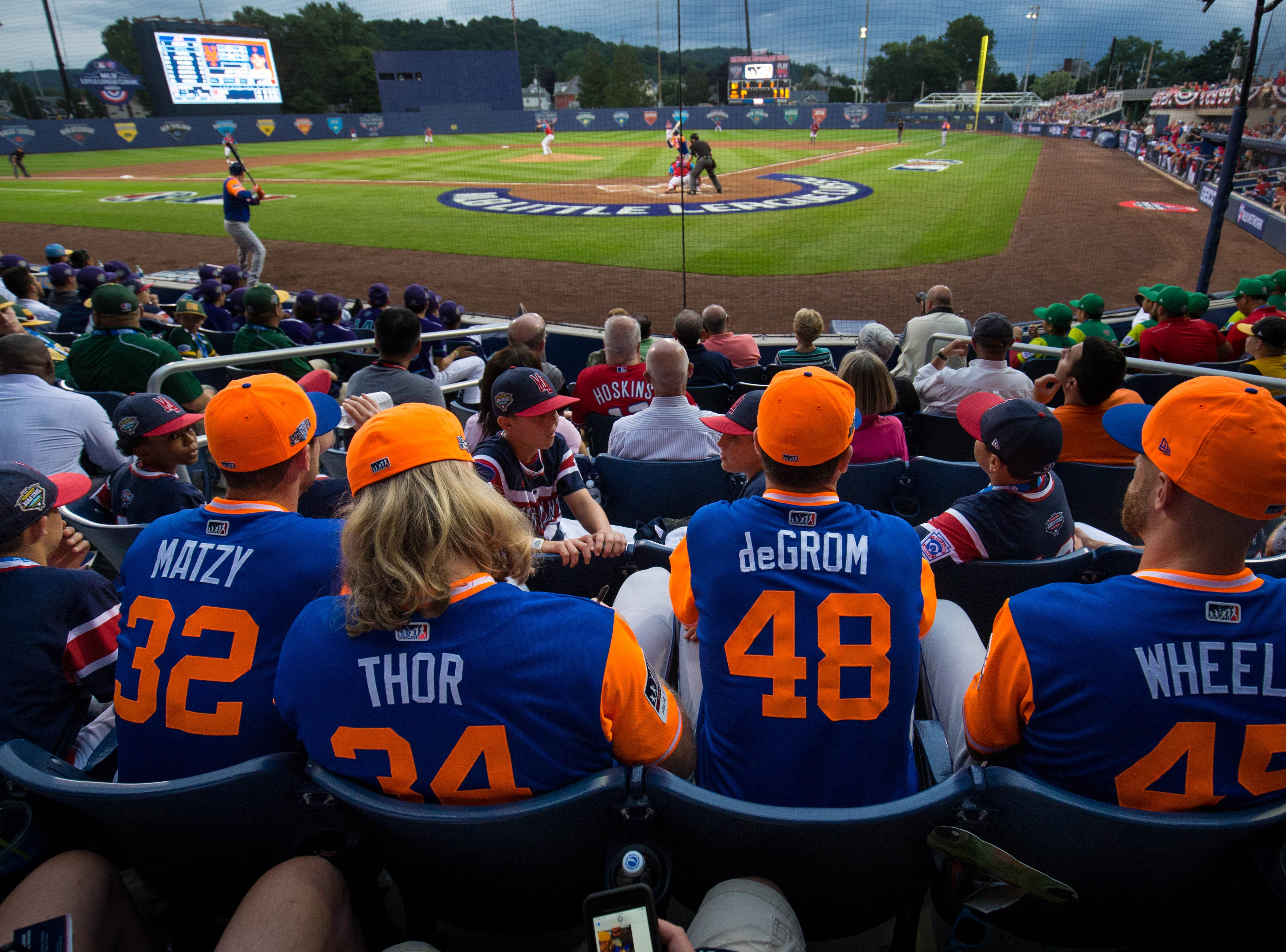 Aug. 19: New York Mets starting pitchers Steven Matz, Noah Syndergaard, Jacob deGrom and Zack Wheeler watch the game with little league players during the second inning against the Philadelphia Phillies at BB&T Ballpark at Historic Bowman Field.