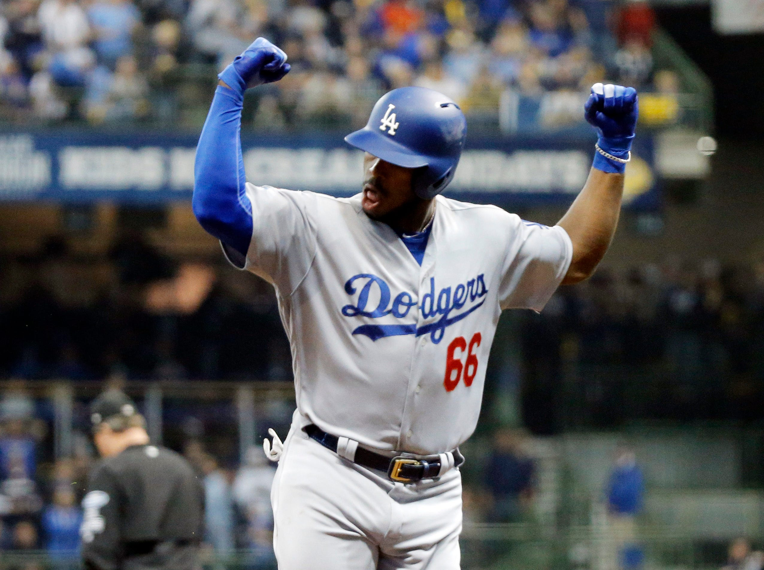 Oct. 20: Los Angeles Dodgers outfielder Yasiel Puig (66) celebrates after hitting a three-run home run against the Milwaukee Brewers in the sixth inning of Game 7 of the NLCS.