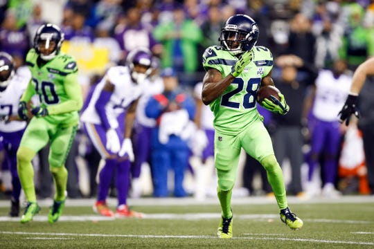 Seattle Seahawks cornerback Justin Coleman (28) returns a fumble for a touchdown against the Minnesota Vikings during the fourth quarter at CenturyLink Field.