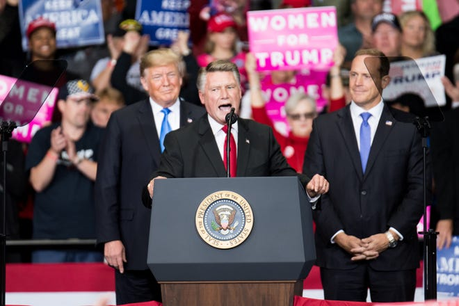 Republican congressional candidate Mark Harris addresses a rally attended by President Donald Trump in Charlotte, North Carolina, on Oct. 26, 2018.