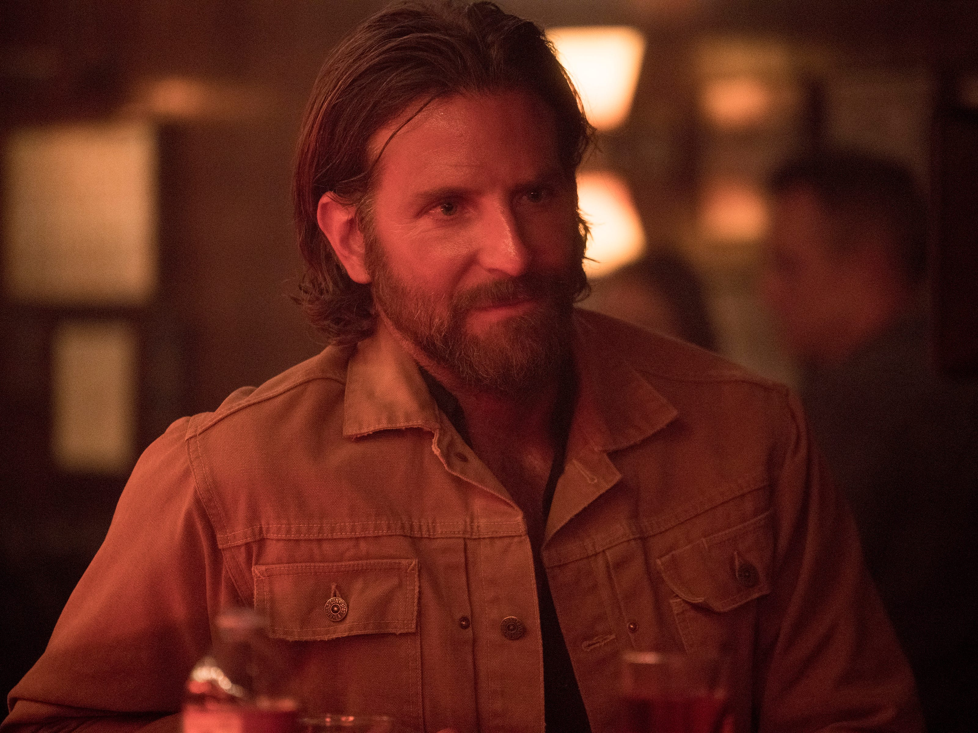 "This image released by Warner Bros. shows Bradley Cooper in a scene from the latest reboot of the film, ""A Star is Born."" On Thursday, Dec. 6, 2018, Cooper was nominated for a Golden Globe award for lead actor in a motion picture drama for his role in the film. The 76th Golden Globe Awards will be held on Sunday, Jan. 6. (Clay Enos/Warner Bros. via AP) ORG XMIT: NYET817"
