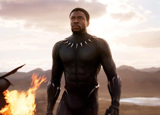 """This image released by Disney and Marvel Studios' shows Chadwick Boseman in a scene from """"Black Panther."""" As Hollywood's awards season properly gets under way, """"Black Panther"""" is poised to be the first comic book film to be nominated for best picture. (Marvel Studios/Disney via AP) ORG XMIT: NYET221"""