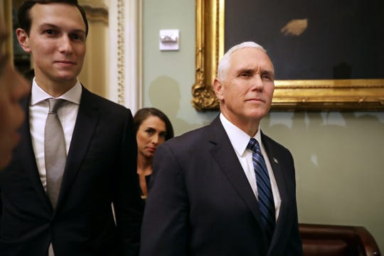 Vice President Mike Pence and White House senior adviser Jared Kushner arrive Nov. 27 for the weekly Senate Republican policy luncheon at the U.S. Capitol. Pence and Kushner urged senators to consider rewriting the nation's criminal justice sentencing system.