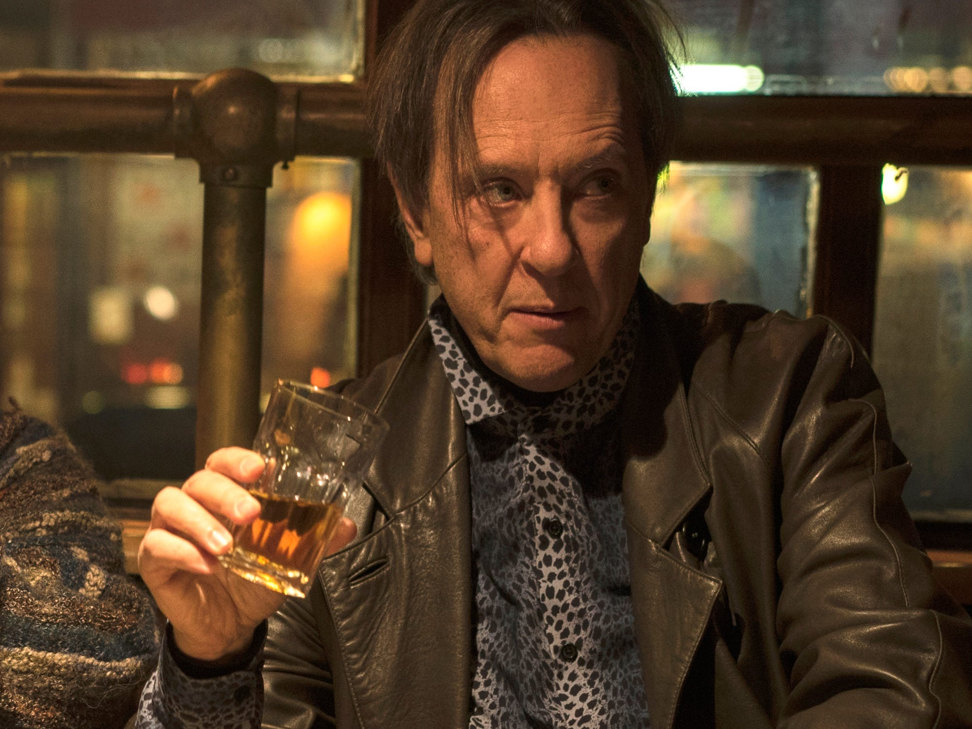 "This image released by Fox Searchlight Films shows Melissa McCarthy, left, and Richard E. Grant in a scene from ""Can You Ever Forgive Me?"" On Thursday, Dec. 6, 2018, Grant was nominated for a Golden Globe award for supporting actor in a motion picture for his role in the film. The 76th Golden Globe Awards will be held on Sunday, Jan. 6. (Mary Cybulski/Fox Searchlight via AP) ORG XMIT: NYET840"