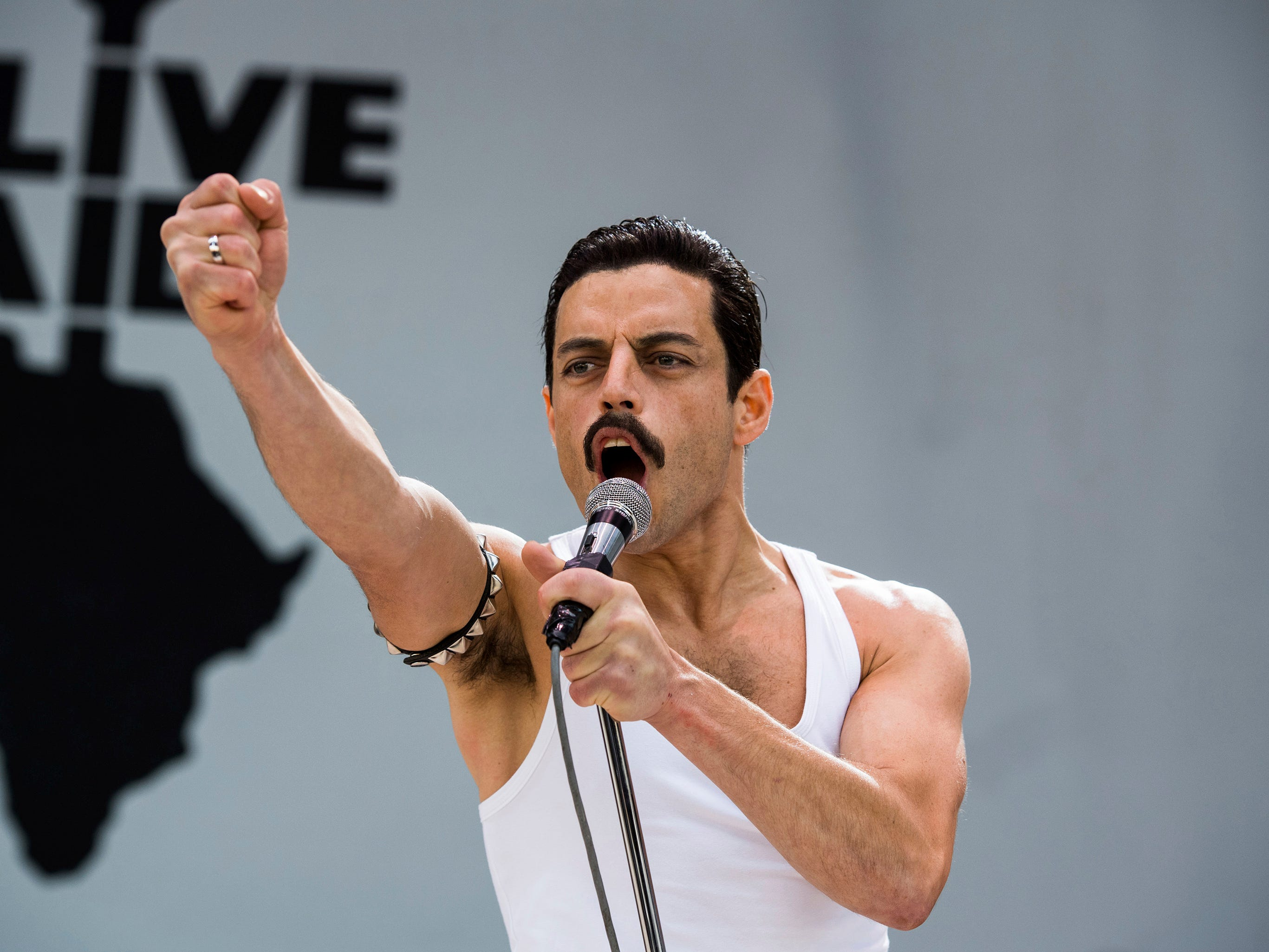 "This image released by Twentieth Century Fox shows Rami Malek in a scene from ""Bohemian Rhapsody."" On Thursday, Dec. 6, 2018, Malek was nominated for a Golden Globe award for lead actor in a motion picture drama for his role in the film. The 76th Golden Globe Awards will be held on Sunday, Jan. 6. (Alex Bailey/Twentieth Century Fox via AP) ORG XMIT: NYET820"