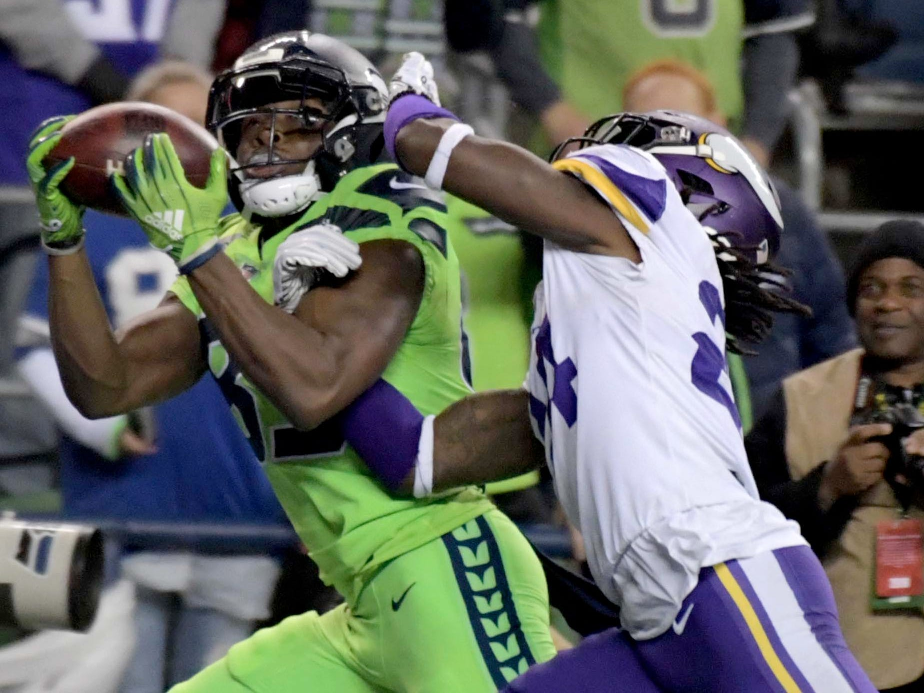 Seattle Seahawks wide receiver David Moore makes a catch in front of Minnesota Vikings defensive back Holton Hill during the first half at CenturyLink Field.