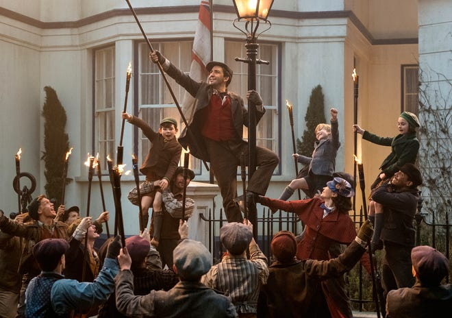 "This image released by Disney shows Lin-Manuel Miranda, center, in ""Mary Poppins Returns.""  On Thursday, Dec. 6, 2018, Miranda was nominated for a Golden Globe award for lead actor in a motion picture comedy or musical for his role in the film. The 76th Golden Globe Awards will be held on Sunday, Jan. 6.  (Jay Maidment/Disney via AP) ORG XMIT: NYET831"