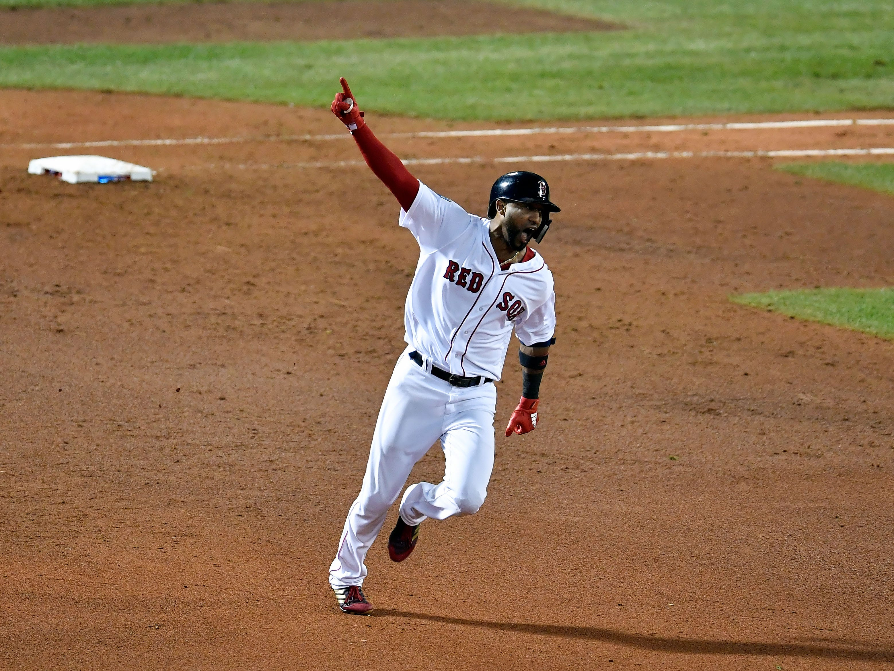 Oct. 23: Boston Red Sox pinch hitter Eduardo Nunez celebrates after hitting a three-run home run against the Los Angeles Dodgers during the seventh inning in Game 1 of the World Series.