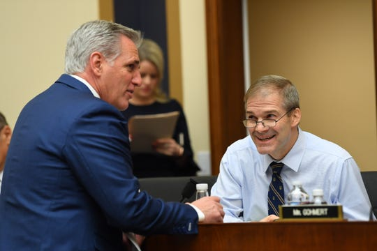 House Majority Leader Kevin McCarthy of Calif., left, and Rep. Jim Jordan, R-Ohio, talke before hearing testimony from Google CEO Sundar Pichai at a hearing before the House Judiciary Committee, Tuesday, Dec. 11, 2018, in Washington. [Via MerlinFTP Drop]