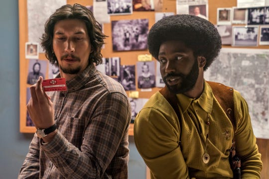 "Adam Driver, left, and John David Washington in ""BlacKkKlansman."""