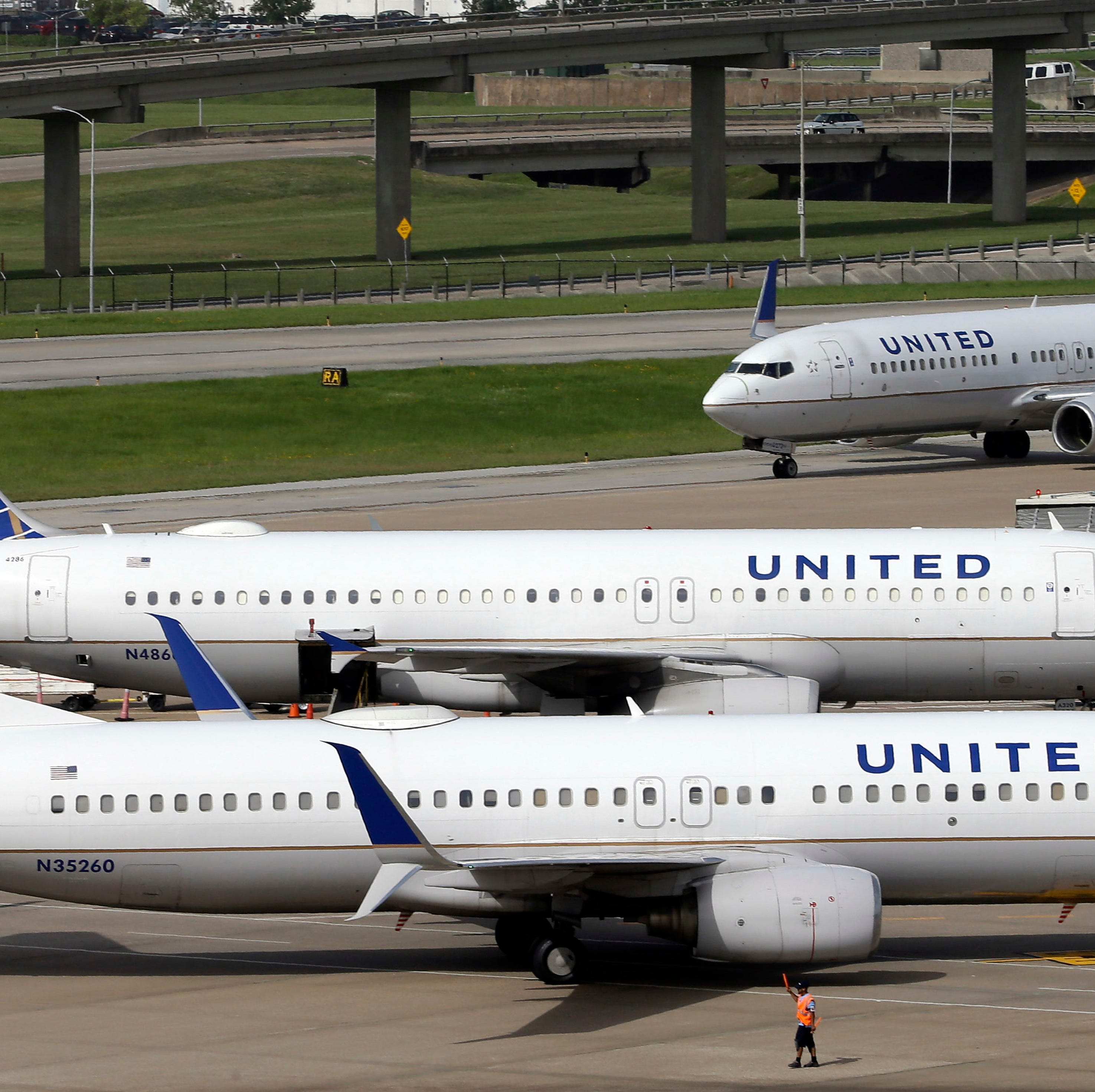 "FILE - In this July 8, 2015, file photo, United Airlines planes are seen on the tarmac at the George Bush Intercontinental Airport in Houston. United Airlines says a disruptive passenger on a flight from Shanghai to New Jersey was asked to get off, resulting in an unscheduled stop in San Francisco and an arrival delayed by eight hours. Videos on social media showed an unidentified elderly man wearing a red ""Make America Great Again"" cap heatedly insisting that he was entitled to a seat and yelling at fellow passengers. (AP Photo/David J. Phillip, File) ORG XMIT: BKWS306"