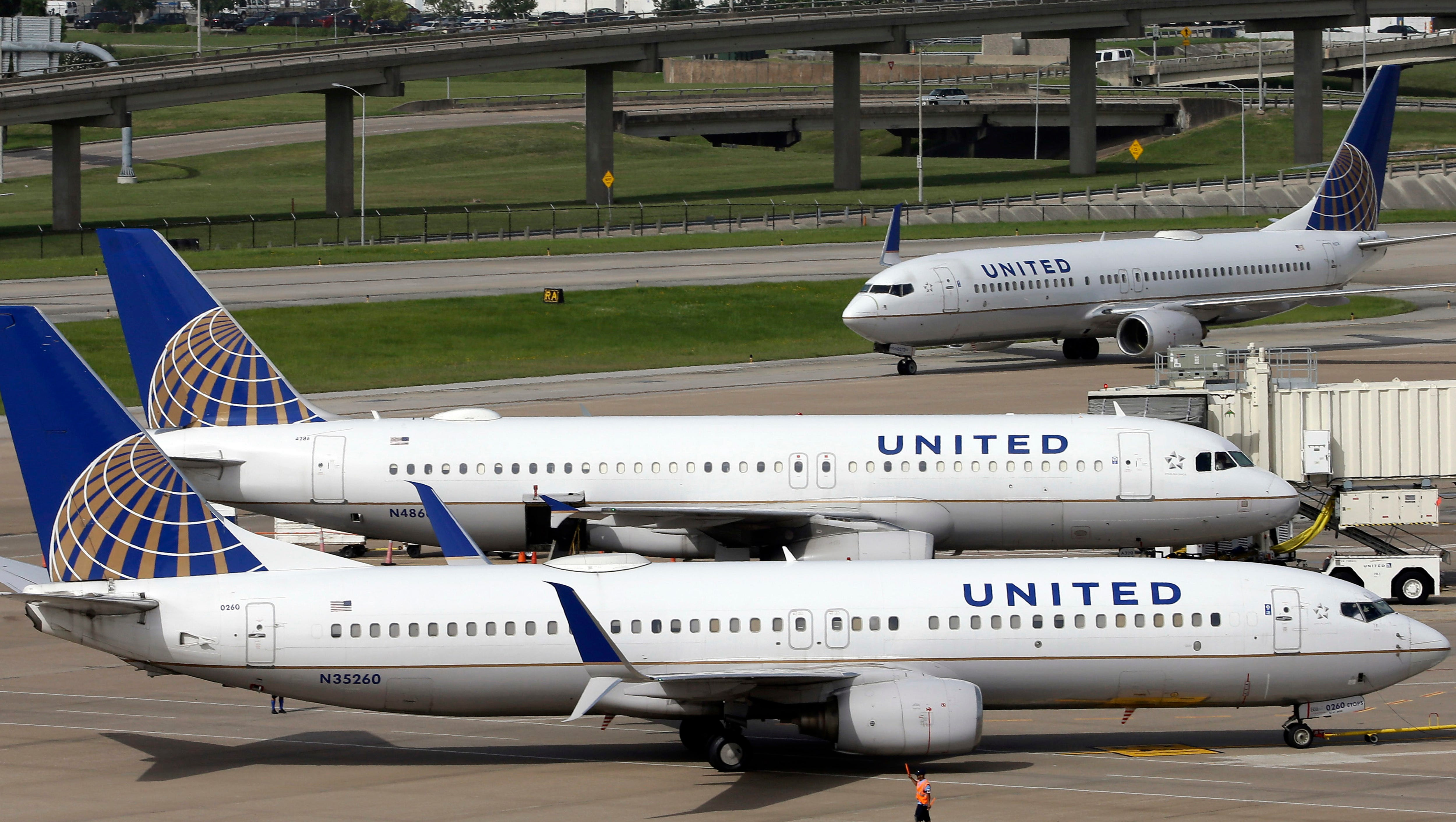 """FILE - In this July 8, 2015, file photo, United Airlines planes are seen on the tarmac at the George Bush Intercontinental Airport in Houston. United Airlines says a disruptive passenger on a flight from Shanghai to New Jersey was asked to get off, resulting in an unscheduled stop in San Francisco and an arrival delayed by eight hours. Videos on social media showed an unidentified elderly man wearing a red """"Make America Great Again"""" cap heatedly insisting that he was entitled to a seat and yelling at fellow passengers. (AP Photo/David J. Phillip, File) ORG XMIT: BKWS306"""