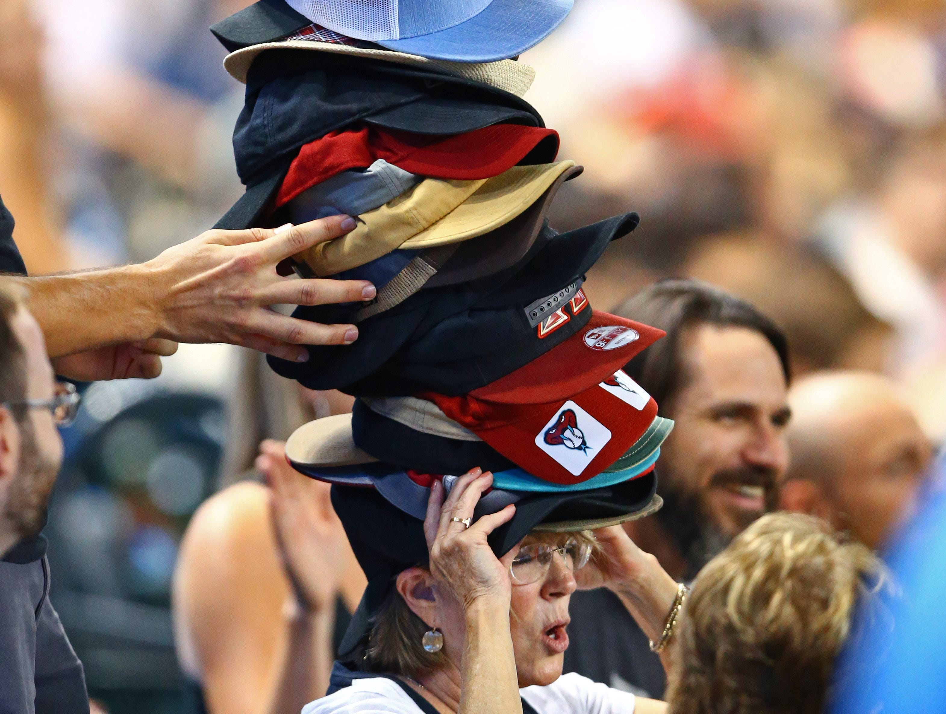 Aug. 6: An Arizona Diamondbacks fan in the crowd wore all the hats during extra innings against the Philadelphia Phillies at Chase Field.