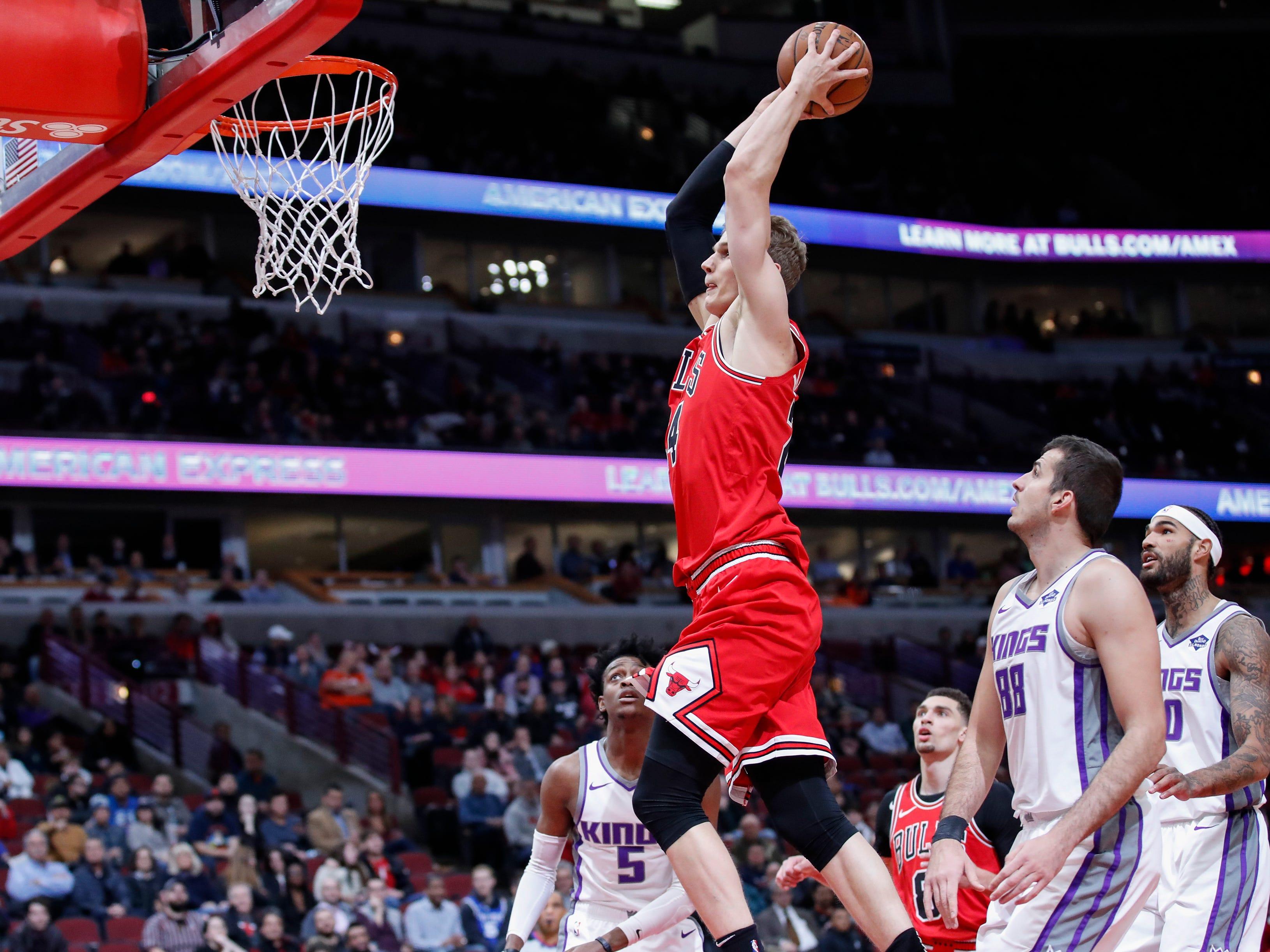 Dec. 10: Bulls forward Lauri Markkanen goes to the basket against the Kings.