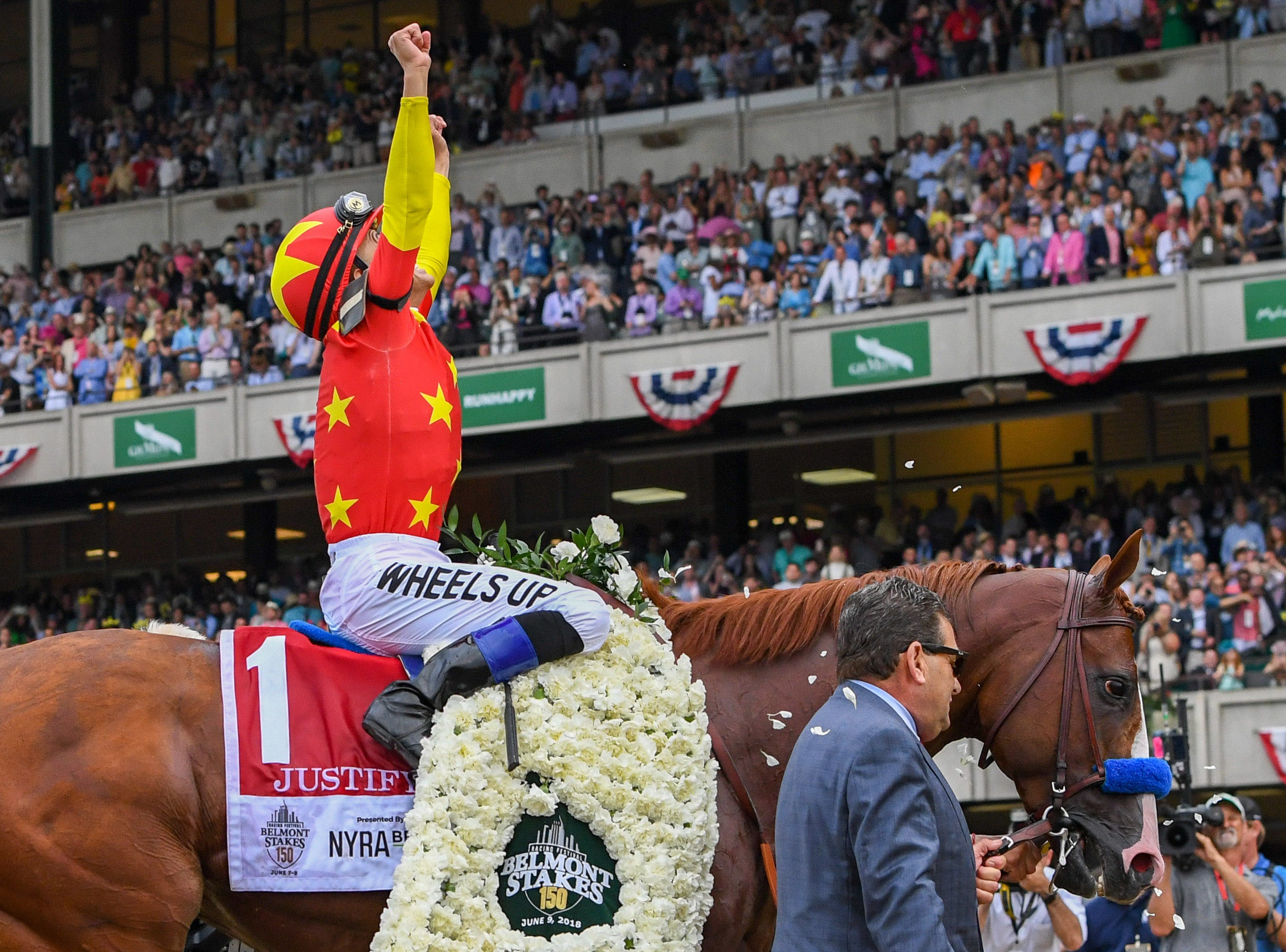 June 9: Mike Smith aboard Justify celebrates winning the Belmont Stakes to complete the Triple Crown.
