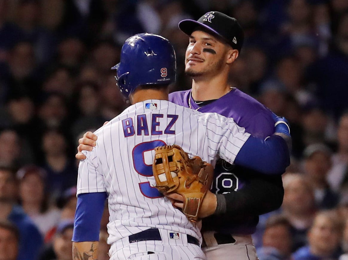 Oct. 2: Chicago Cubs shortstop Javier Baez hugs Colorado Rockies third baseman Nolan Arenado after being tagged out in the 11th inning in the National League wild card game at Wrigley Field.