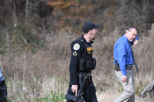 Deputies and police officers searched Wednesday, Dec. 12, 2018, for a man who knocked down an Anderson County Sheriff's Office deputy, took his gun and ran away on Breazeale Street outside of Belton.
