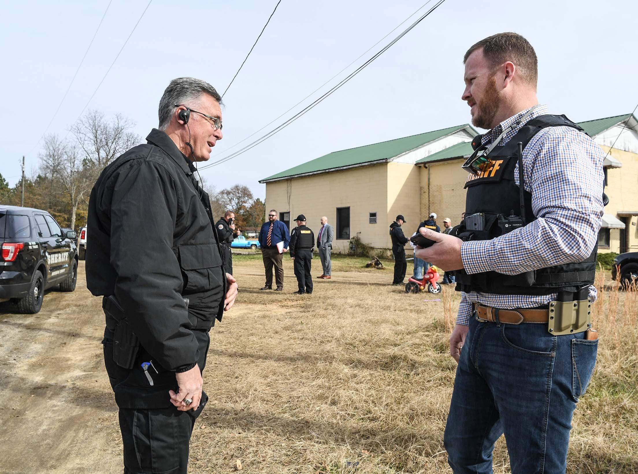 Belton Police Chief Tommy Clamp, left, and Anderson County Sheriff Chad McBrideat Brazeale Street in Belton after a report that a man struck an officer serving a warrant at a house Wednesday, December 12, 2018.