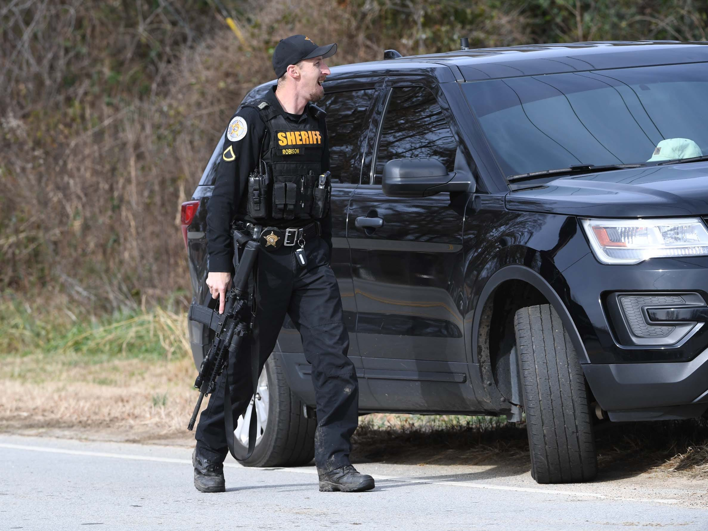 An Anderson County Sheriff Deputy on Brazeale Street in Belton following a report that a man struck an officer serving a warrant at a house Wednesday, December 12, 2018.
